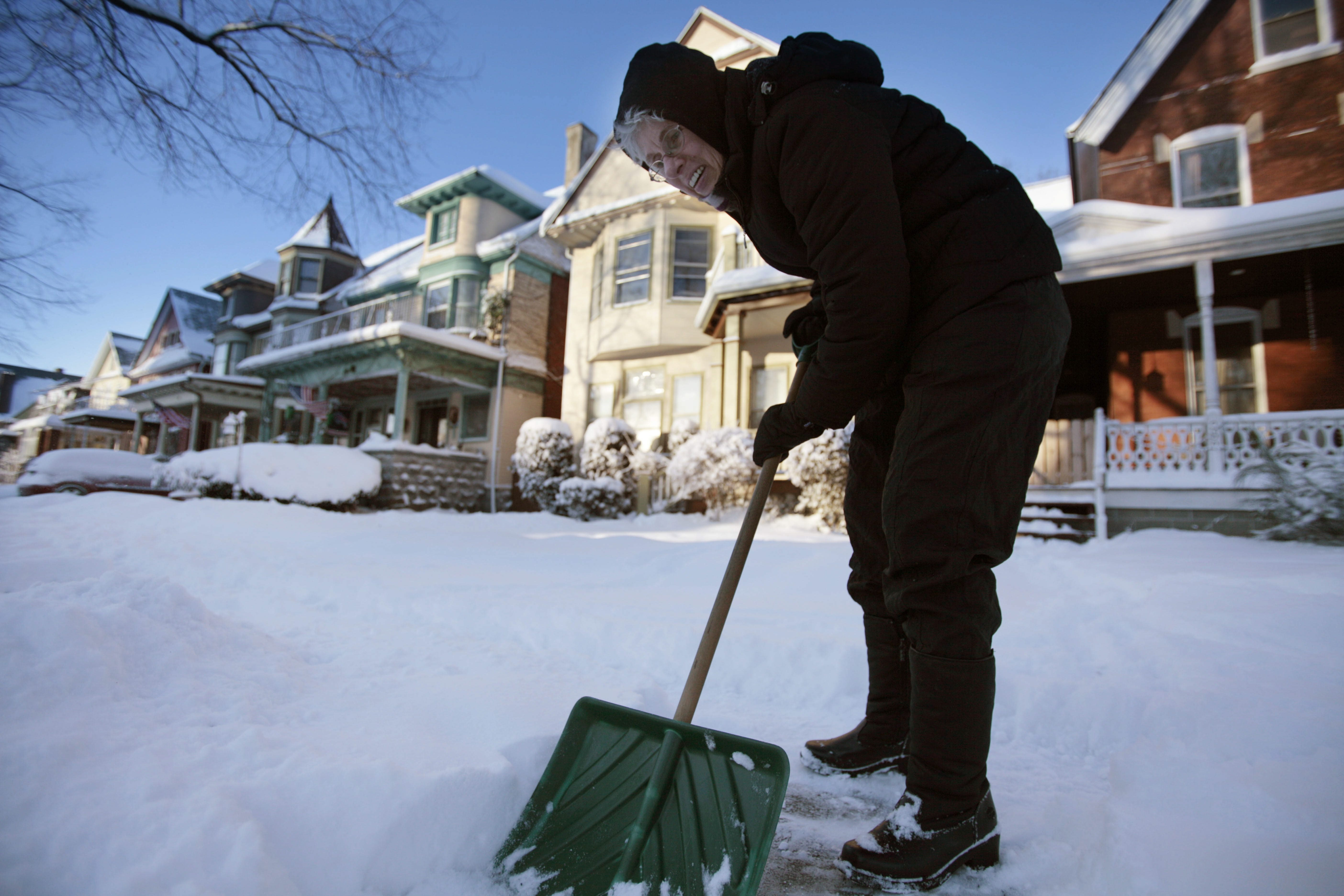 Sue Sellingsloh does some shoveling on Richmond Avenue after an overnight storm left several inches of snow.
