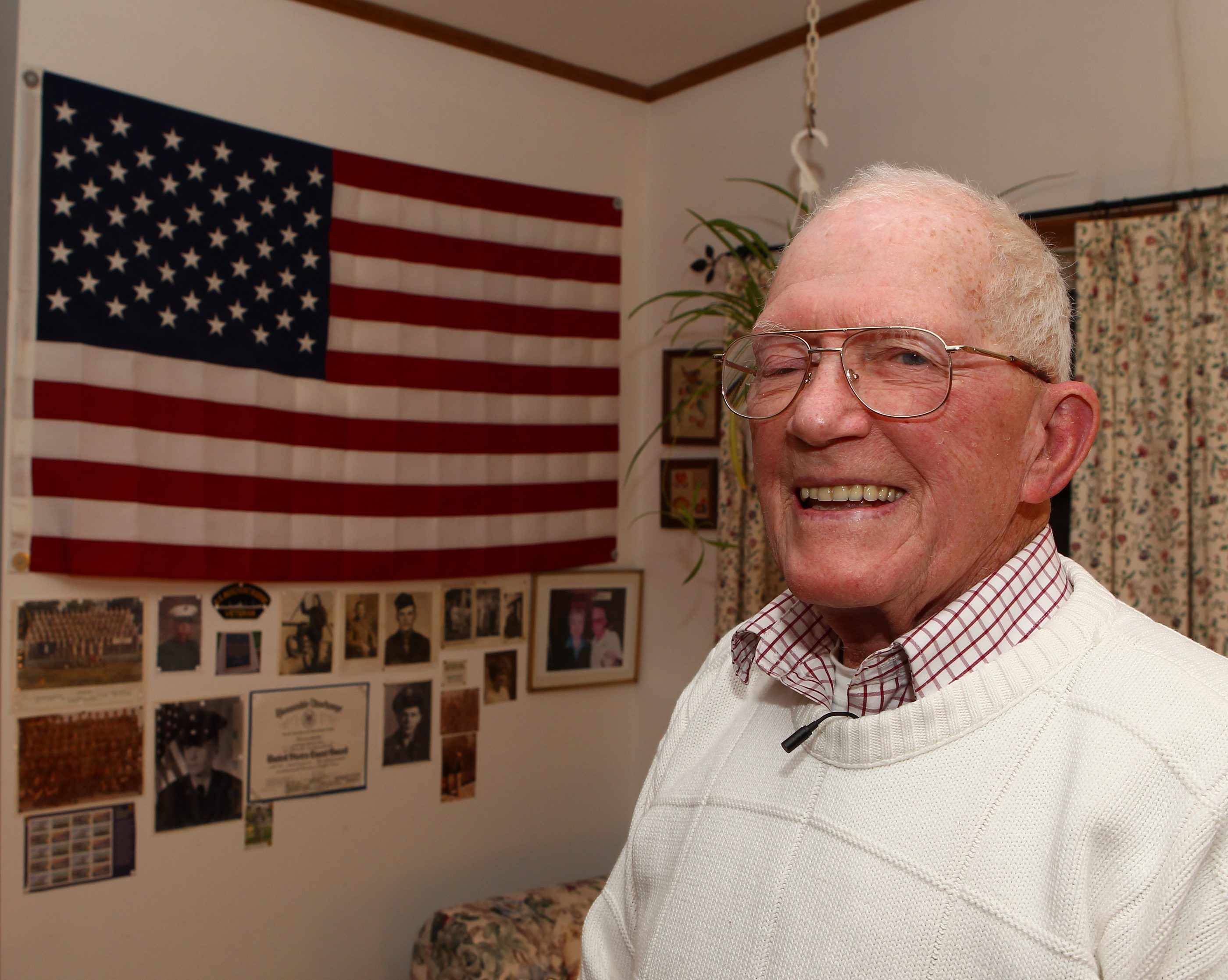 """Lawrence E. Haley, with WWII memorabilia in his Arcade home, was needed in Merchant Marine """"because of the high fatality rate."""""""