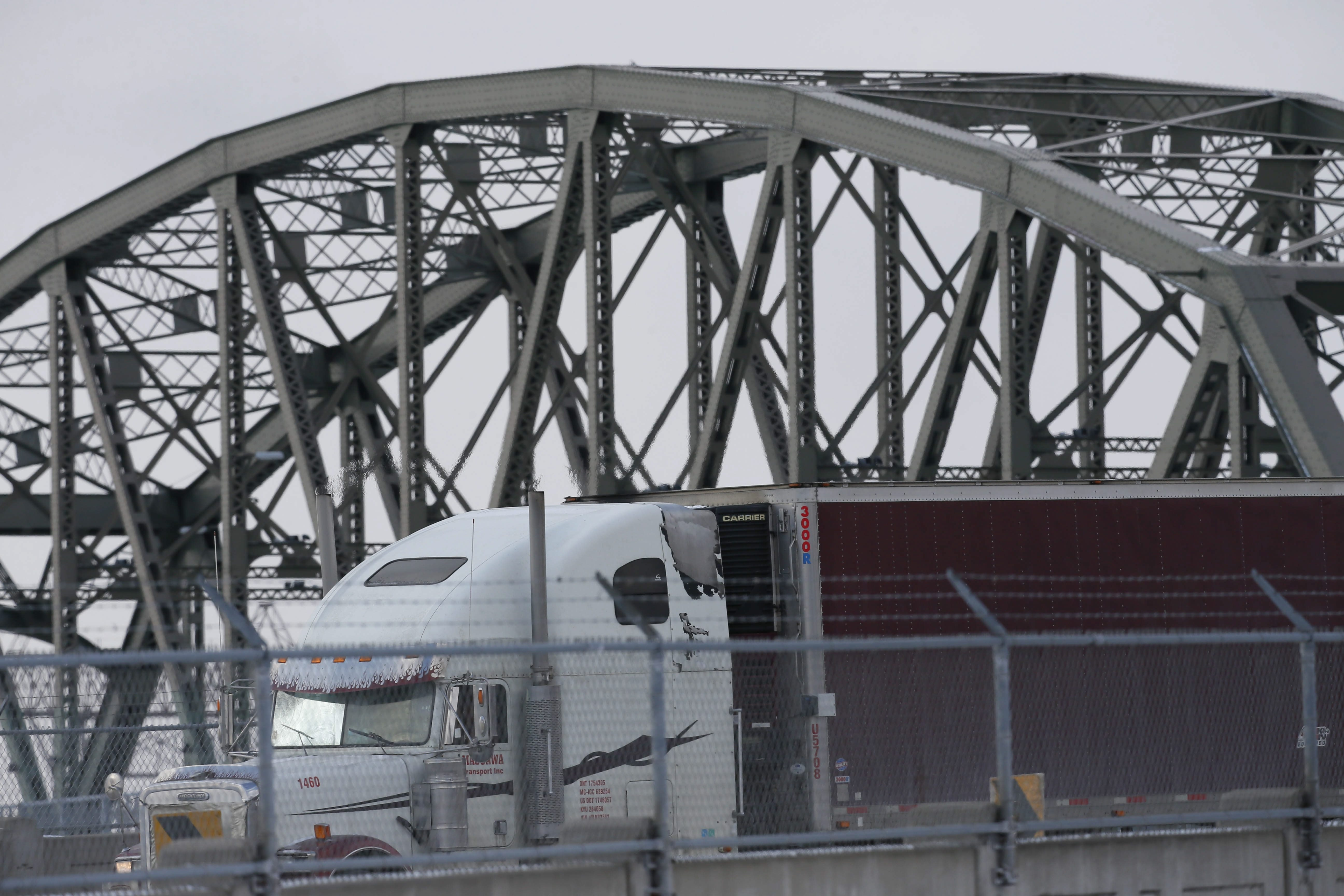 Commercial truck traffic congestion on Peace Bridge and plan for expanded plaza and new ramps have been focus of long battle over environmental impact on West Side neighborhood.