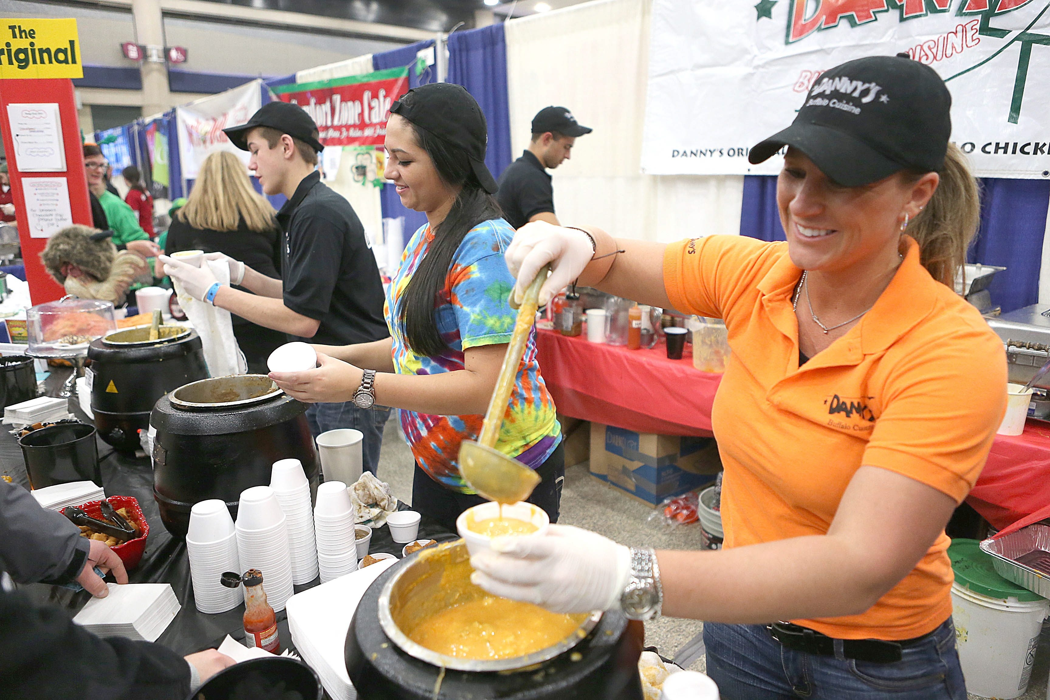 Melinda Ebeling, right, and Melissa Schaumloeffel of Danny's dish out chicken wing and beef on weck soups at the 4th annual Buffalo Soup-Fest at the Buffalo Niagara Convention Center on Sunday.