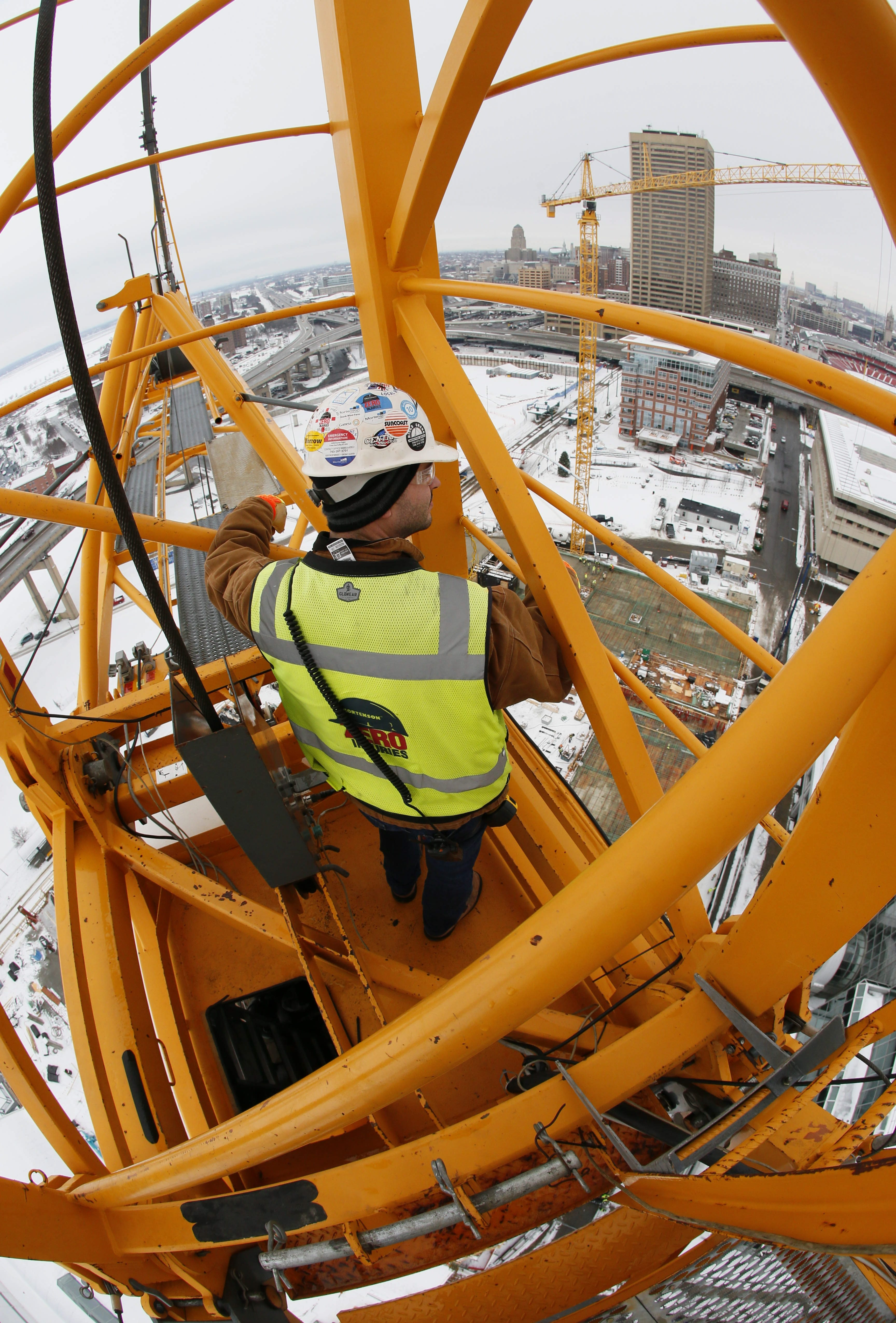 Ryan Poropat, project superintendent for Mortenson Construction, looks out from the top of the south tower crane at HarborCenter on Jan. 10.