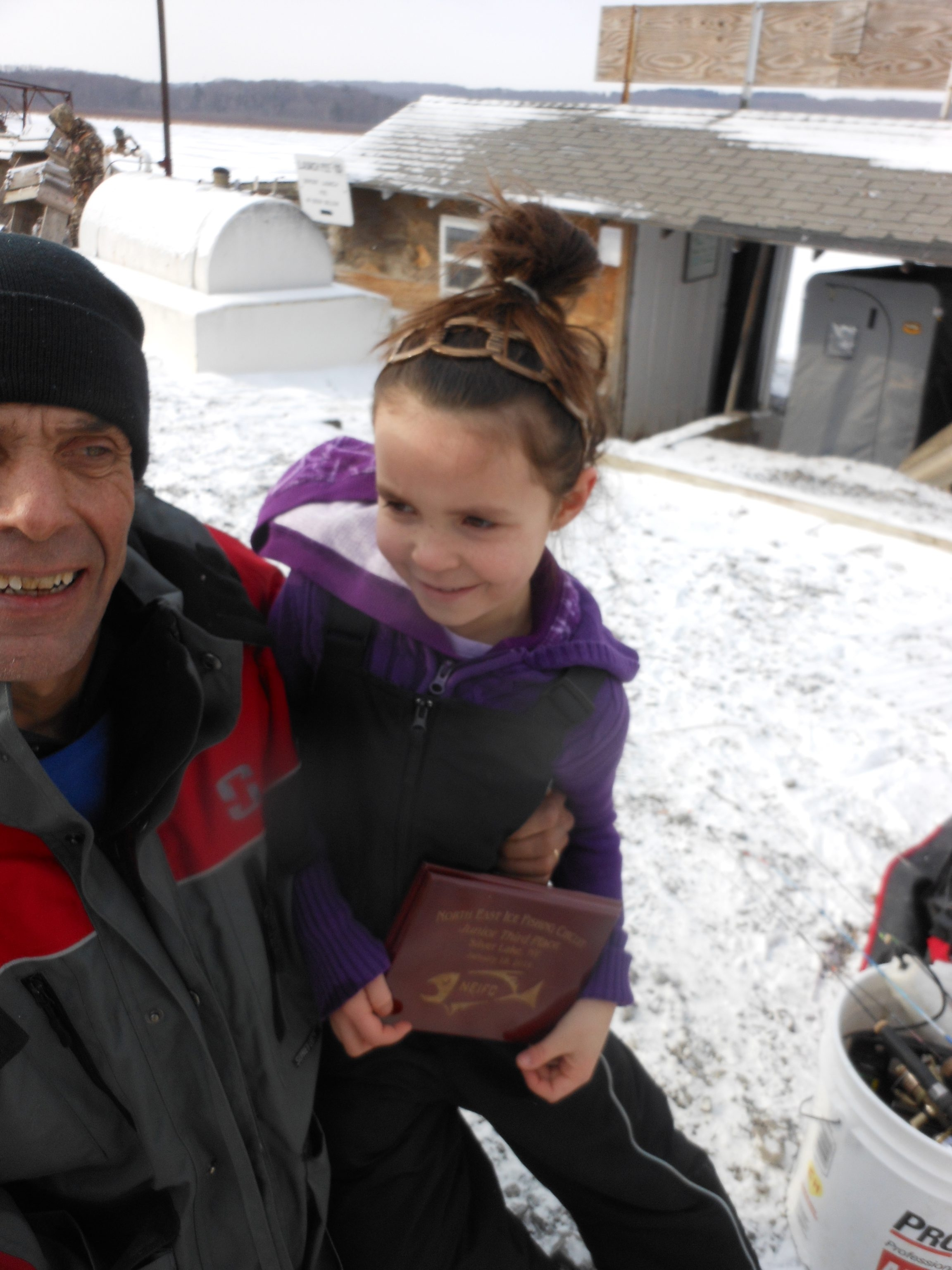 Aliyah Snyder of Warsaw braved chilly winds to take third place in a Silver Lake ice-fishing contest for kids.