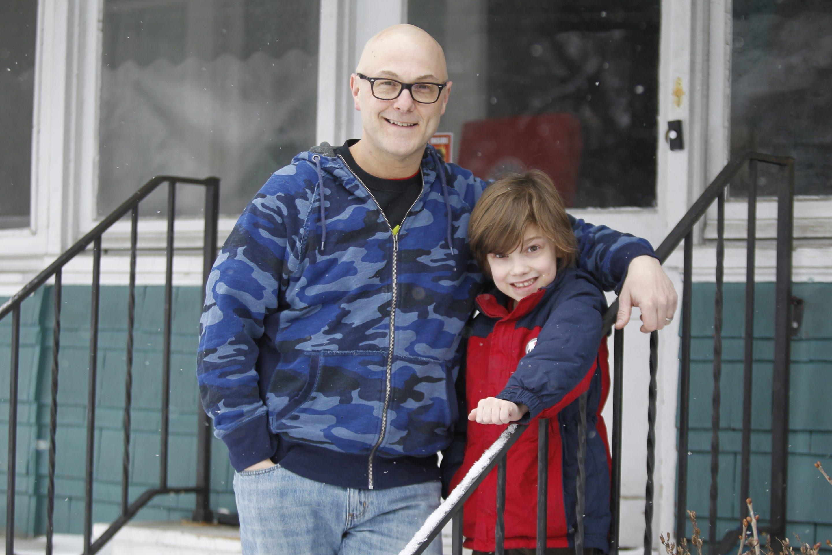 """Jerry Turcotte and his son Max, 7, shown outside their Buffalo home, worked together on a book: """"Exercise Like the Animals A to Z."""""""