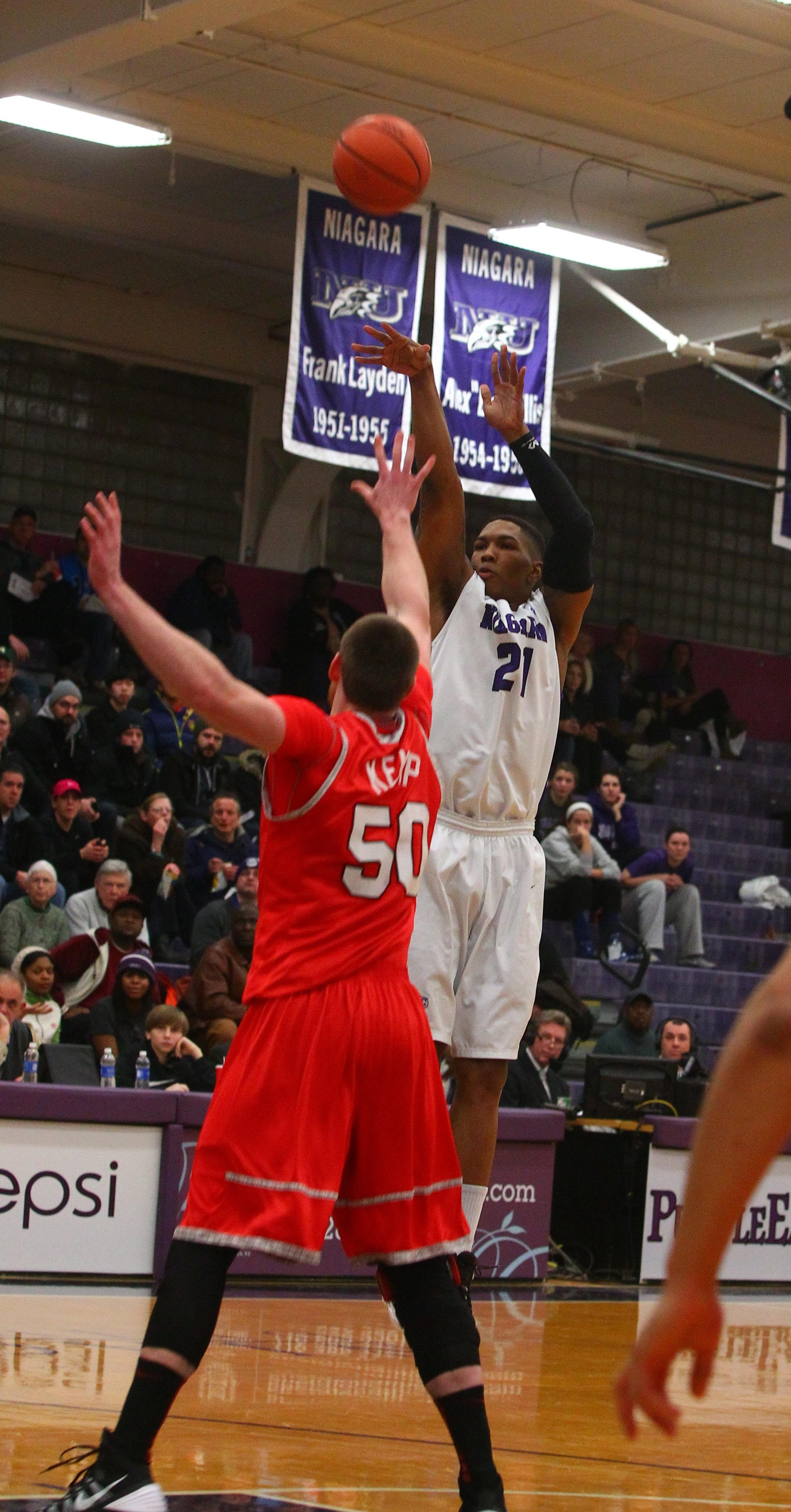 Niagara's Marcus Ware lets fly with a jumper over Marist's Adam Kemp as the host Purple Eagles earned their third victory in the Metro Atlantic Athletic Conference.