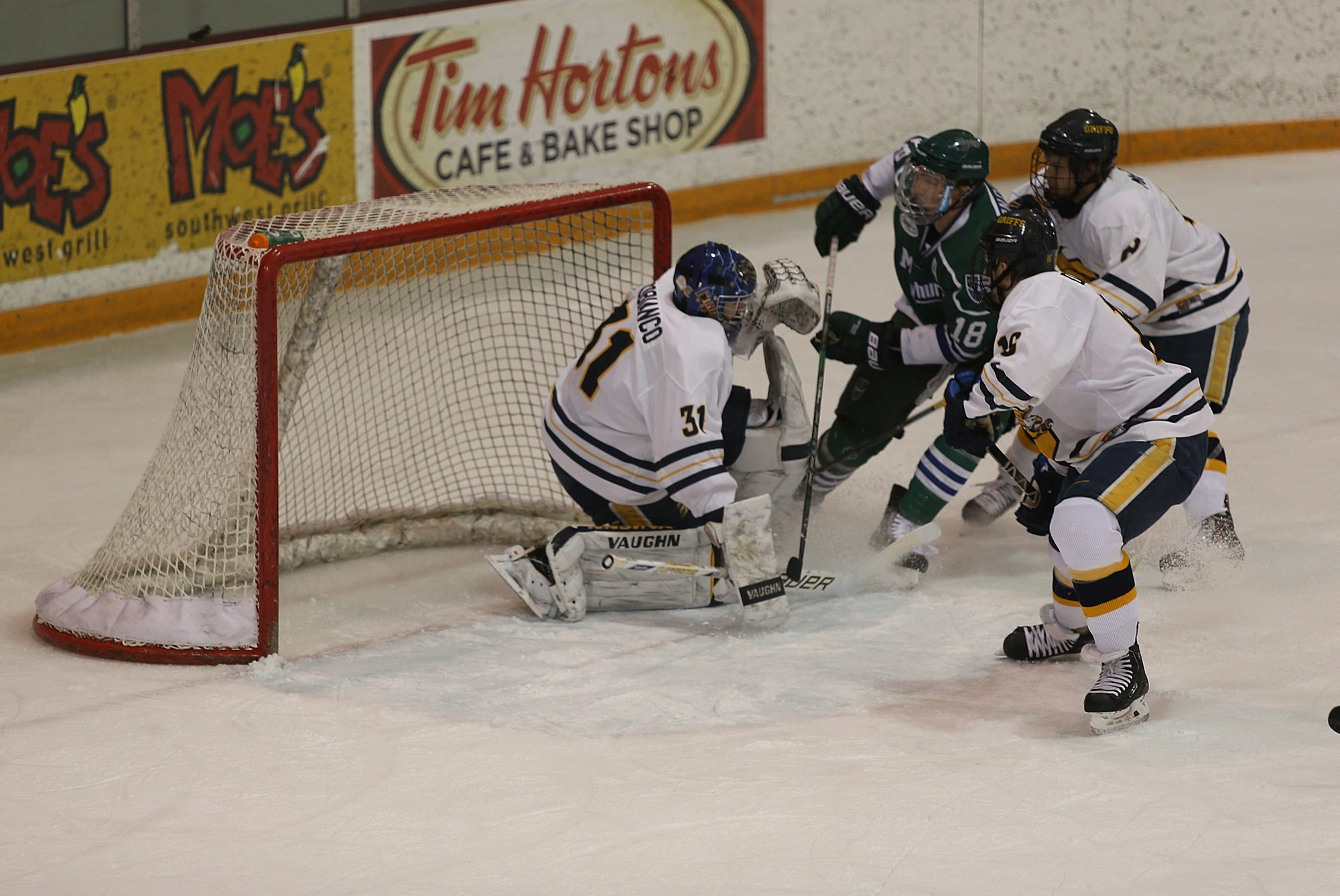 Canisius goaltender Tony Capobianco makes a save against Mercyhurst's Daniel O'Donoghue on Thursday.