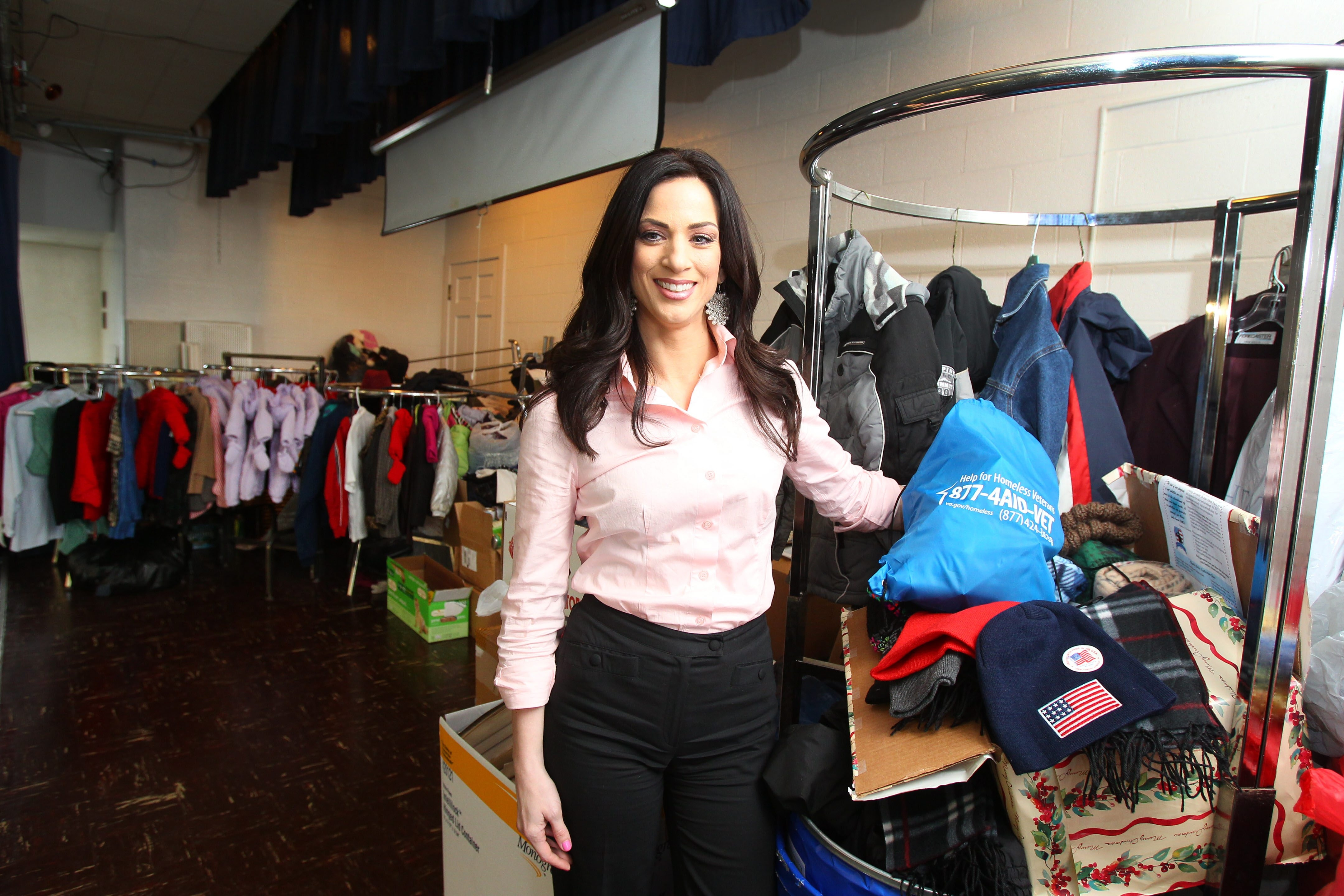 Jennifer O. D'Andrea-Terreri, founder of the not-for-profit Supporting, Empowering, Respecting Veterans and Their Families, or SERV, shows donations gathered at Christ Community Church, where she provides assistance that includes housing options.