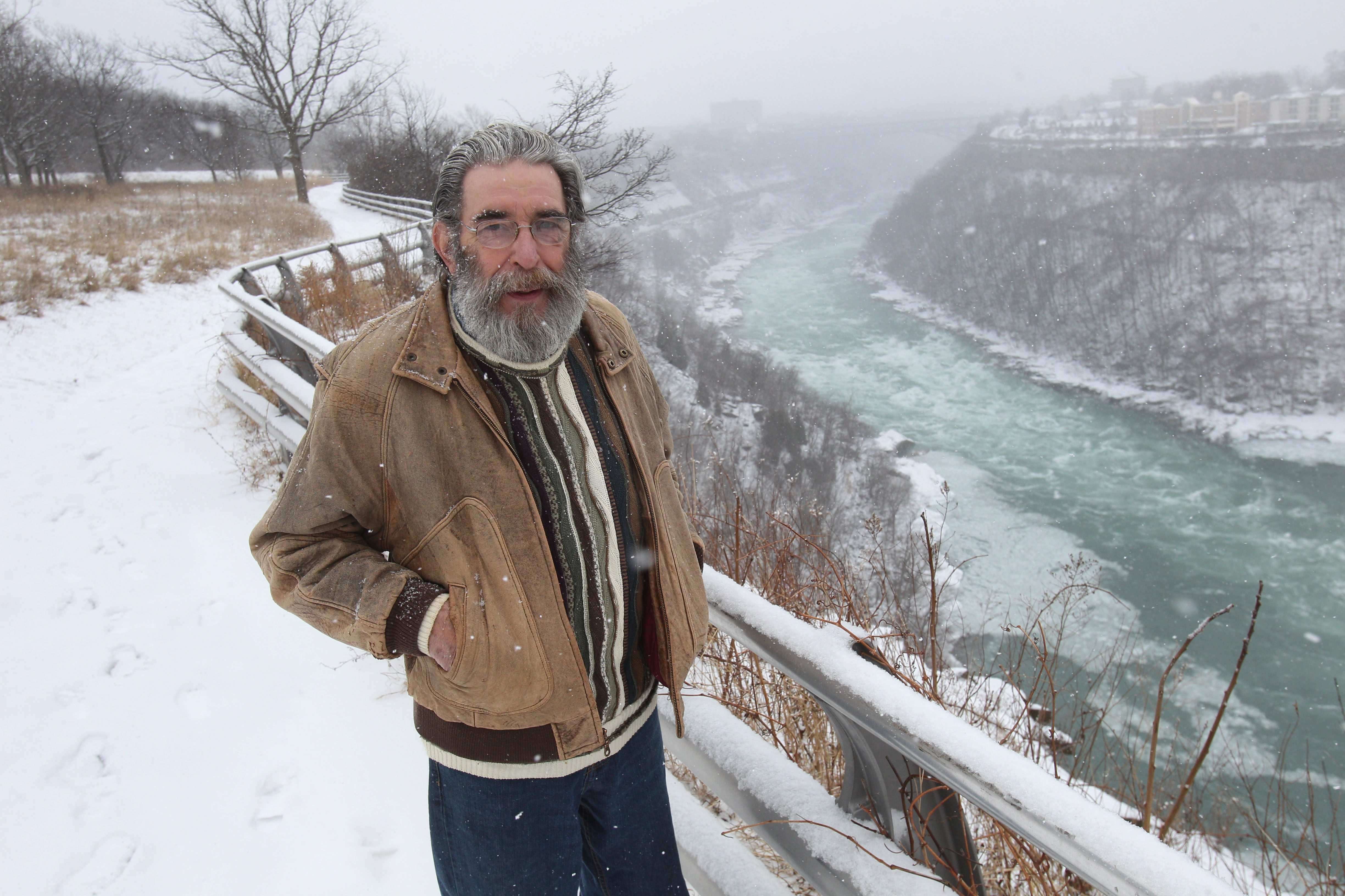 E.R. Baxter III, of Ransomville, is a poet who often writes about the Niagara River. Here he walks in Whirlpool State Park in Niagara Falls.