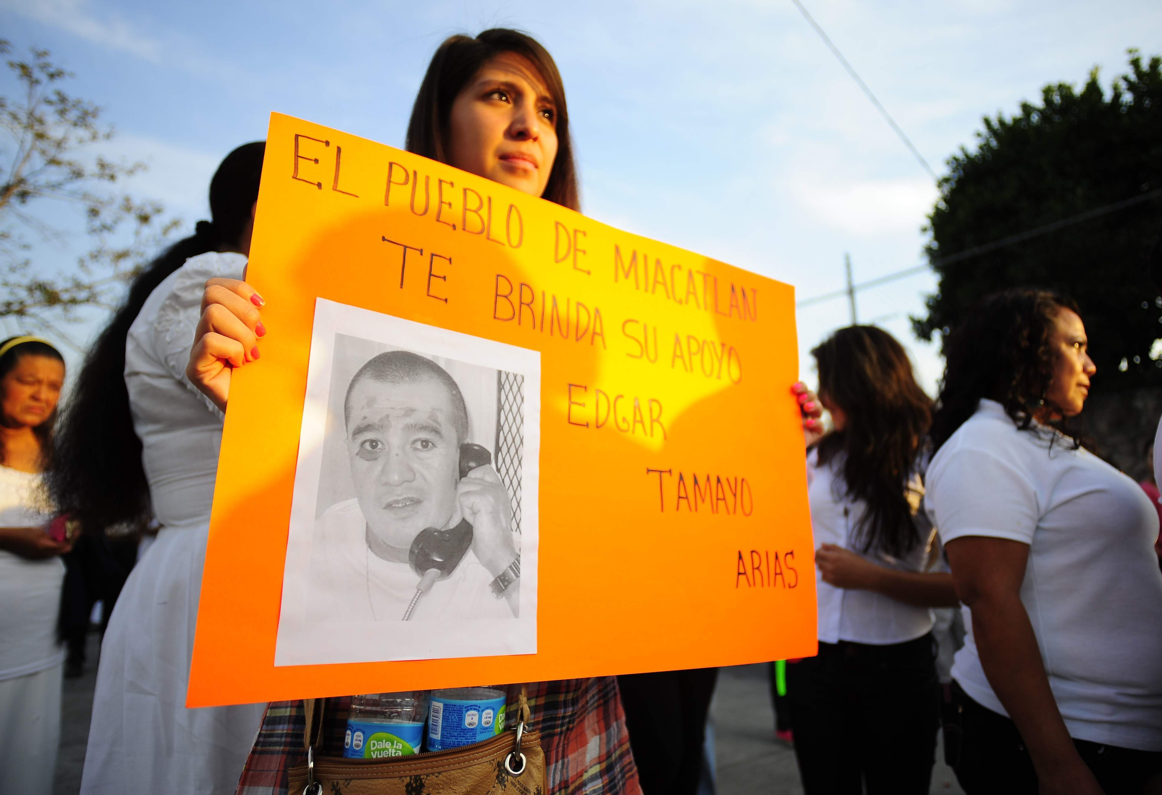 Woman holds a sign in support of Texas death-row inmate Edgar Tamayo in his hometown of Miacatlan, Mexico.