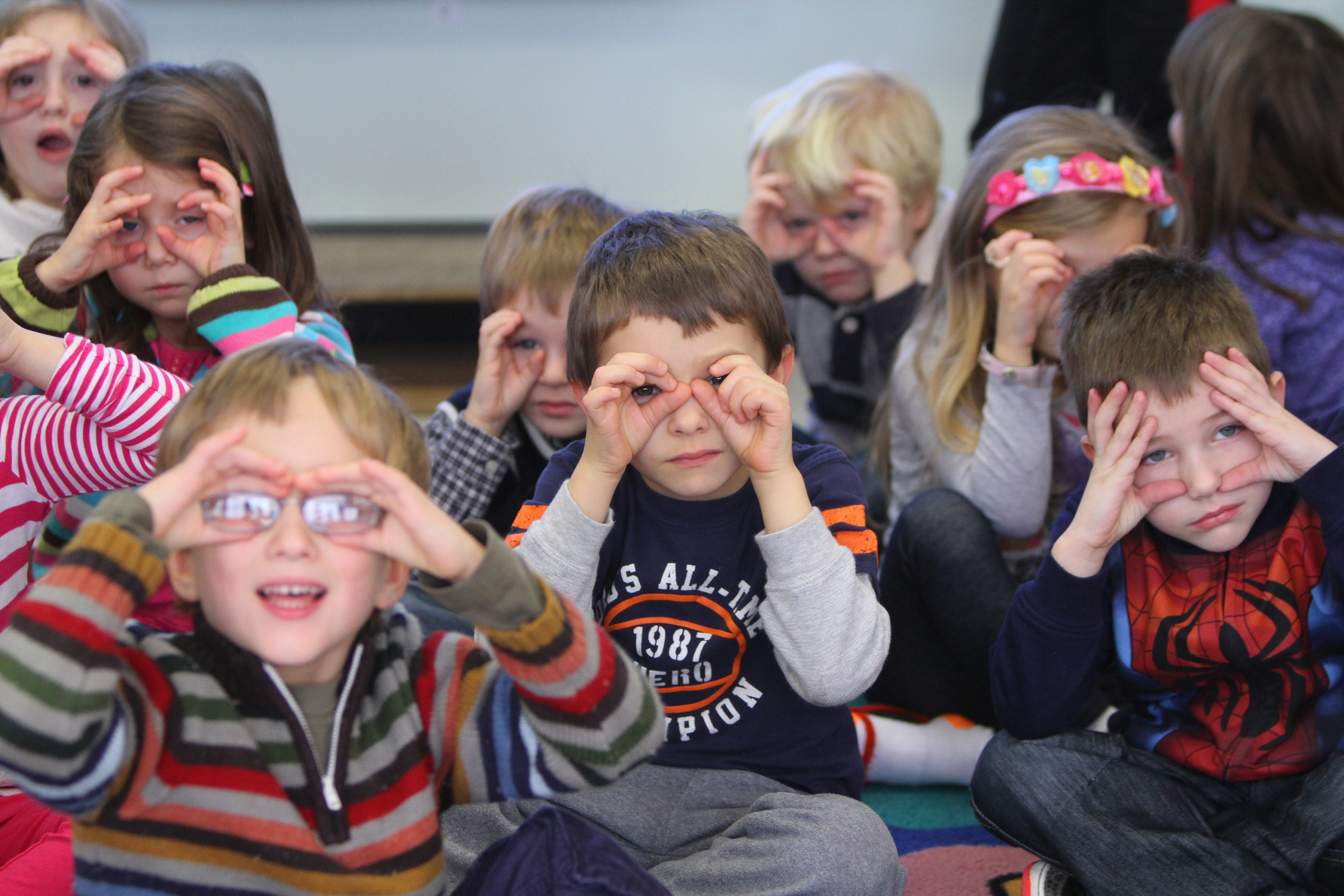 Prekindergarten students use imaginary binoculars to look at weather from Michelle White's classroom at Sidway Elementary, Grand Island. Statewide pre-K is a Cuomo priority.