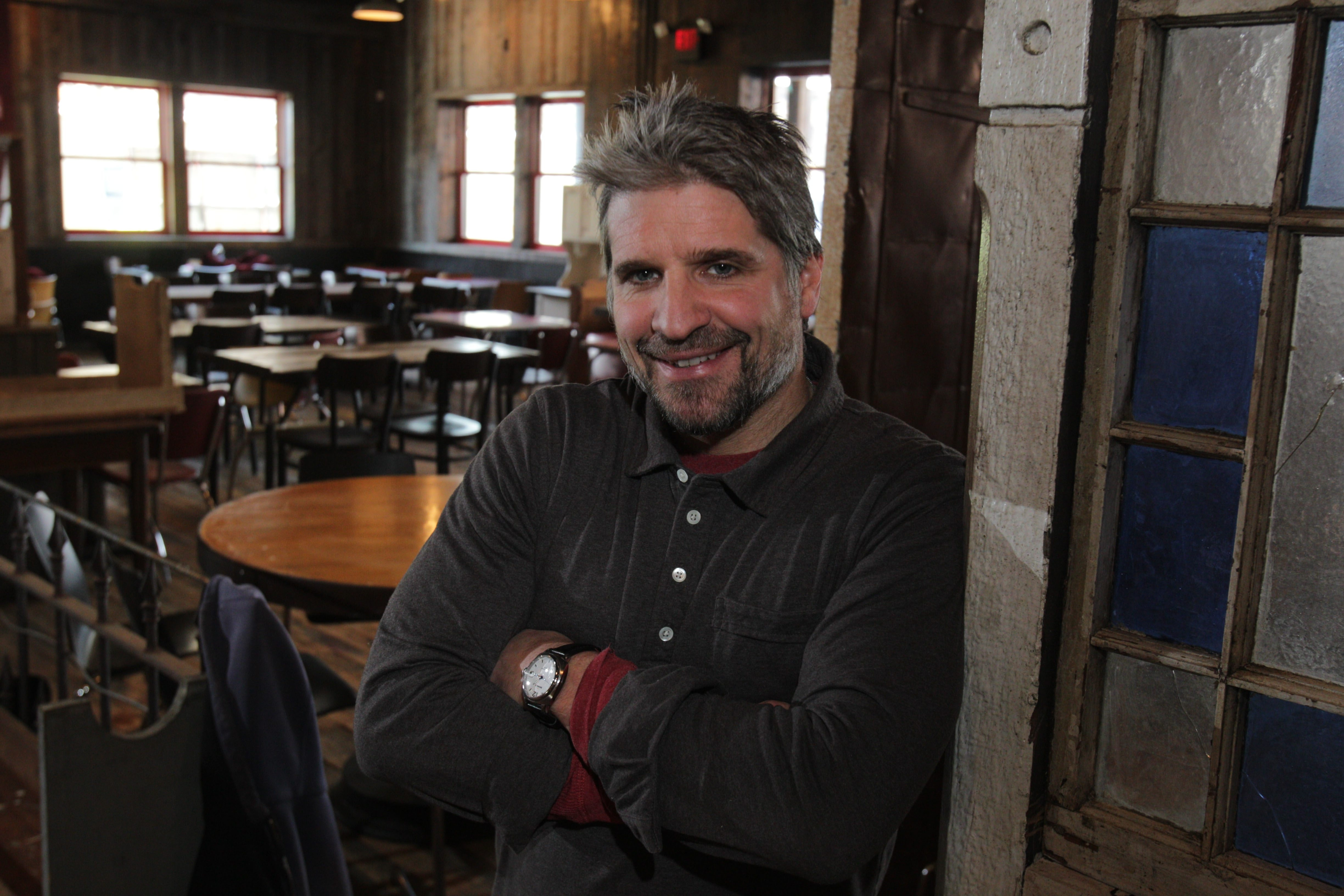 Dinosaur Bar-B-Que CEO John Stage started his barbecue empire cooking out of a 55-gallon drum at biker rallies. Thenew restaurant on Franklin Street is due to open Feb. 12. . in Buffalo,  On right is a dividing  wall constructed from pieces found in the basement.