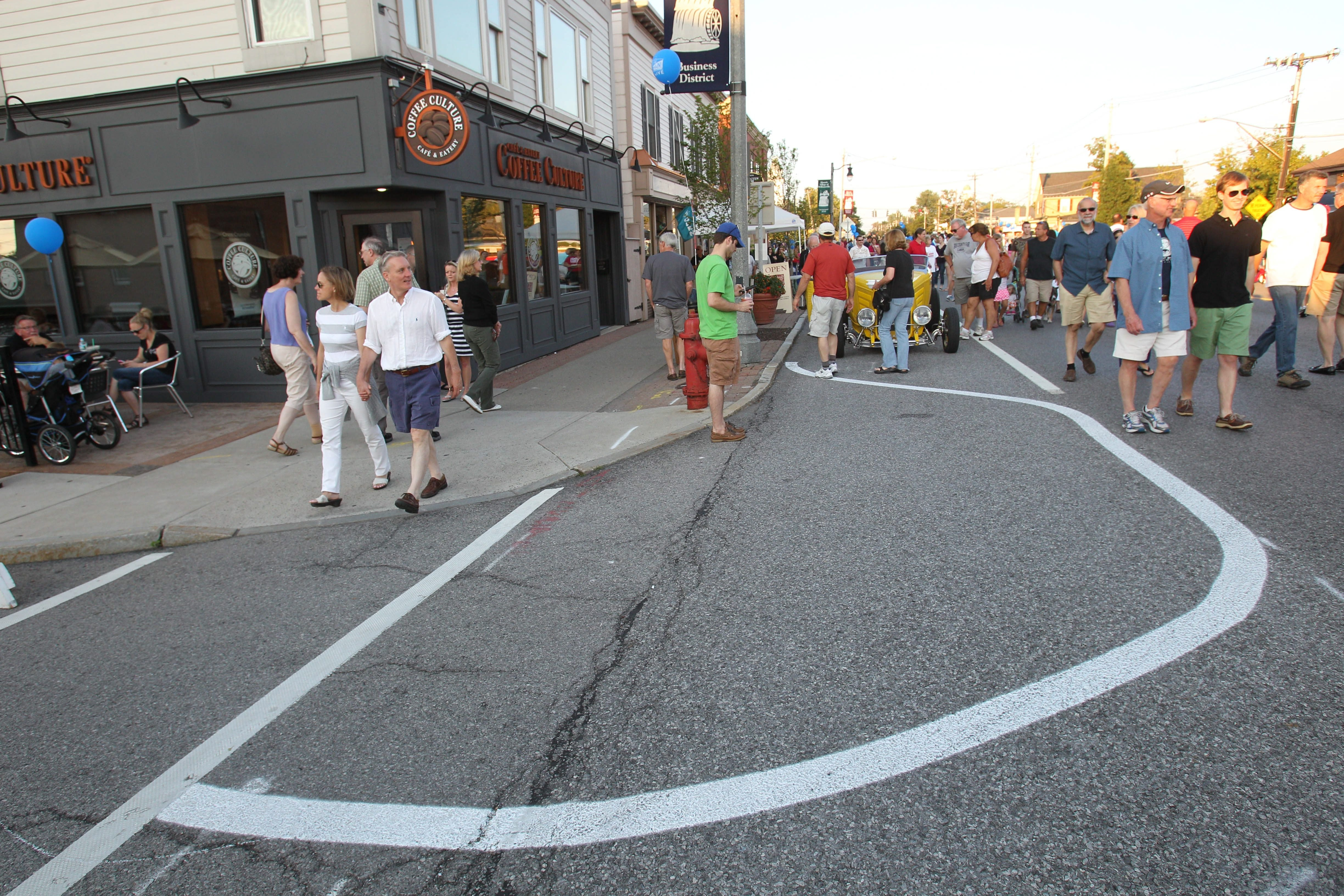 Main Street in Williamsville between Cayuga and Mill streets was closed for a festival for three hours last Aug. 17. Street markings and temporary plantings on Spring Street show some of the changes planned to make the village more pedestrian-friendly.