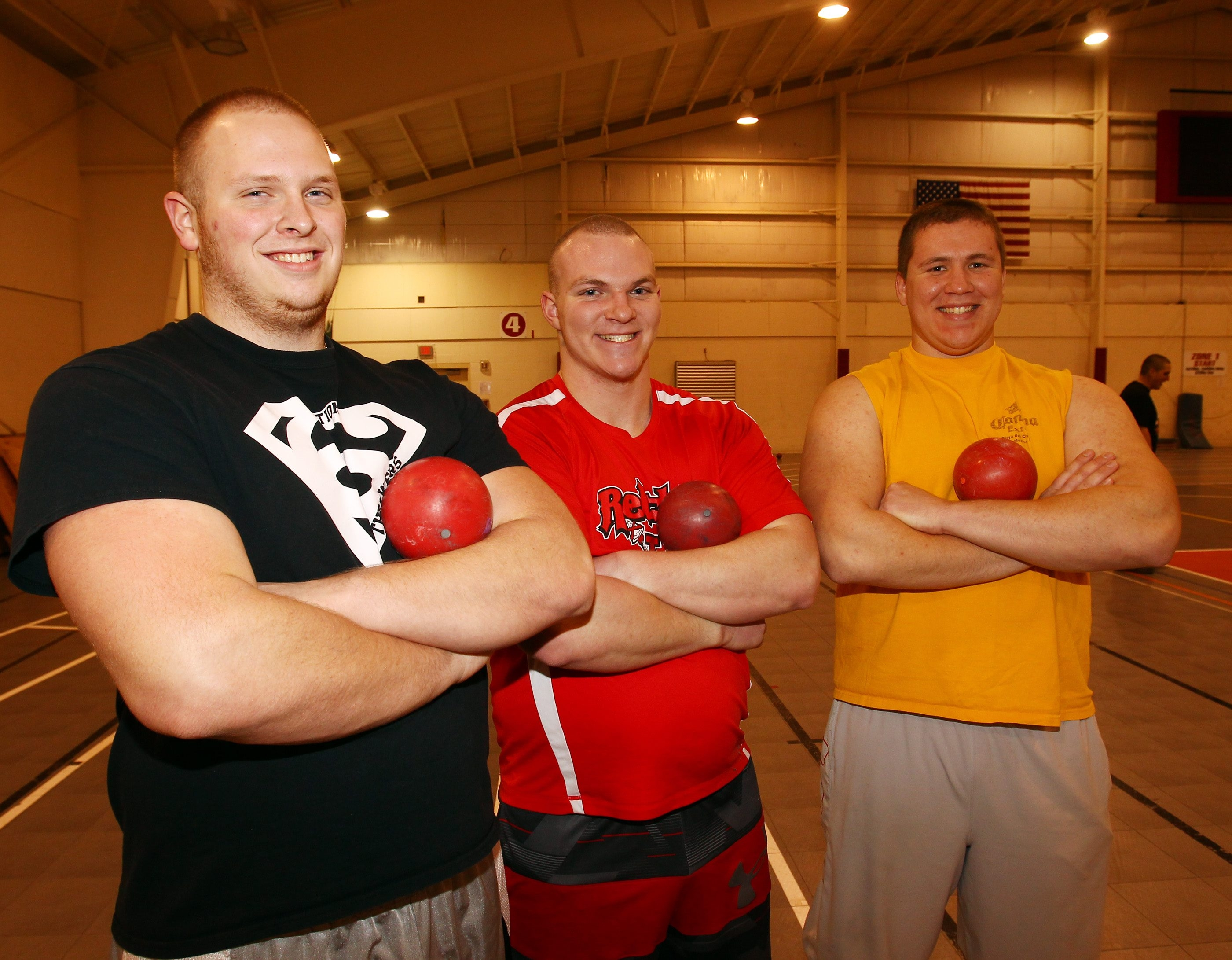 Lancaster throwers Tony DeYoung and Brandon Sicurella, center, are competing with Orchard Park's Dawson Hillis, right, for a chance to go to the state meet.