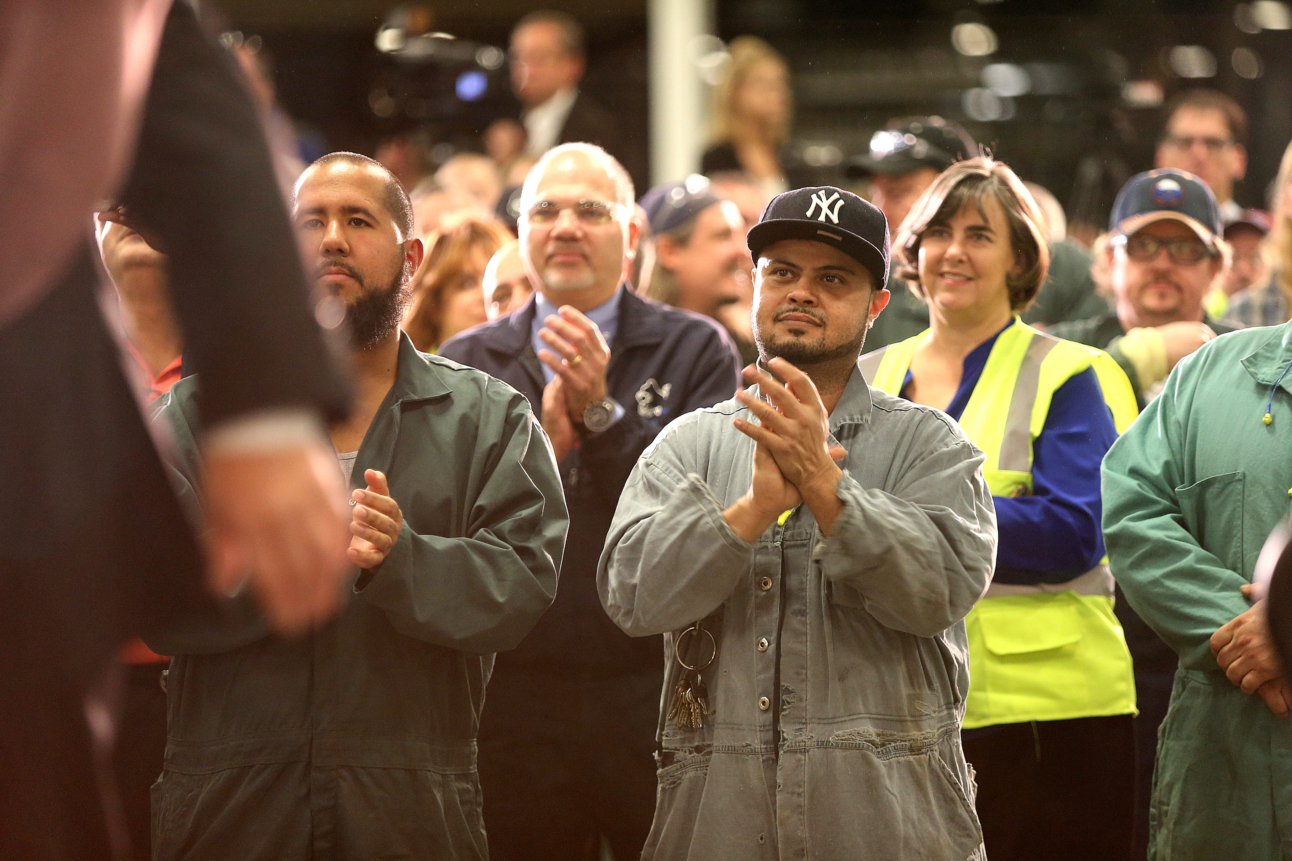 Workers at the Ford Stamping Plant in Hamburg applaud Gov. Andrew M. Cuomo during an announcement that Ford would add workers and invest in their plant.