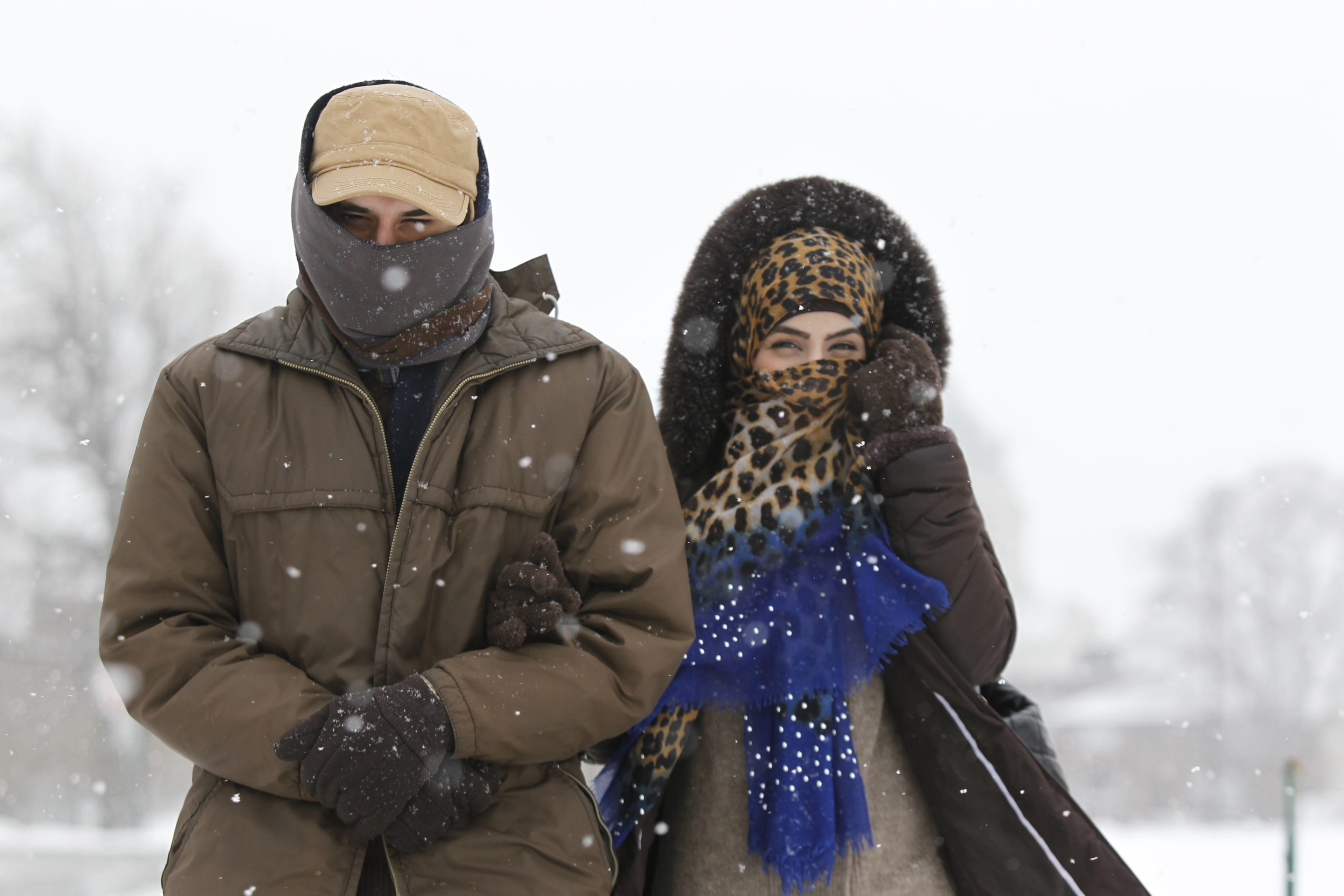 Youssef Farhat and his wife, Alaa Almaliki, are bundled up as they  walk through Cazenovia Park in South Buffalo on a chilly Monday.