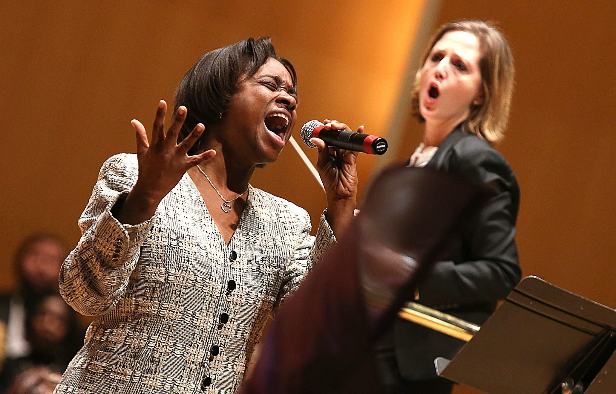 "Soloist Patricia Edwards sings ""Total Praise"" as Conductor Erin Freeman directs the Buffalo Philharmonic Orchestra during the Martin Luther King Jr. celebration in Kleinhans Music Hall on Sunday."