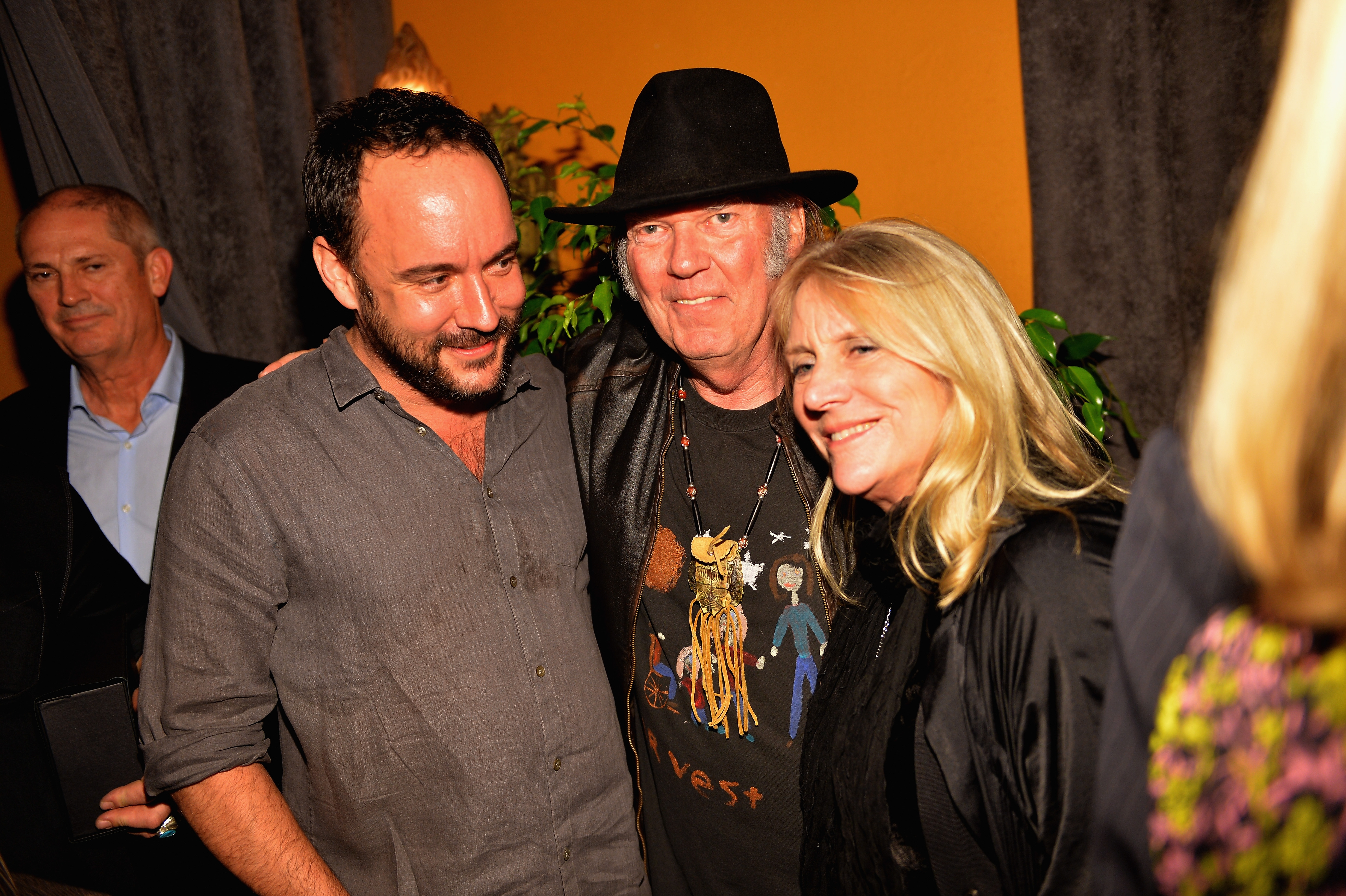 From left, Dave Matthews, Neil Young and Pegi Young attend the Recording Academy event honoring Young Tuesday at The Village Recording Studios in Los Angeles.