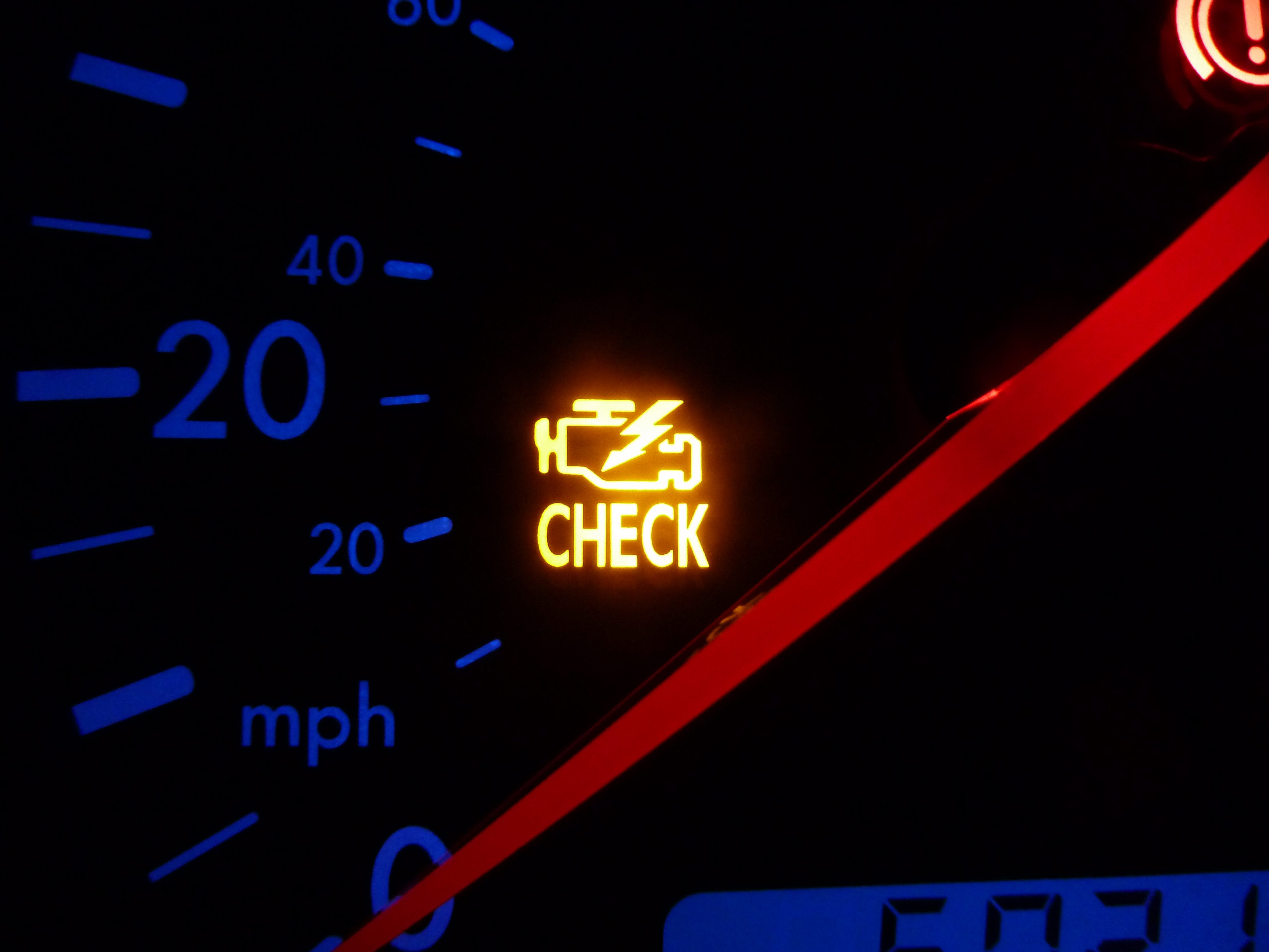 "A glowing ""check engine"" light indicates an emissions-related problem."