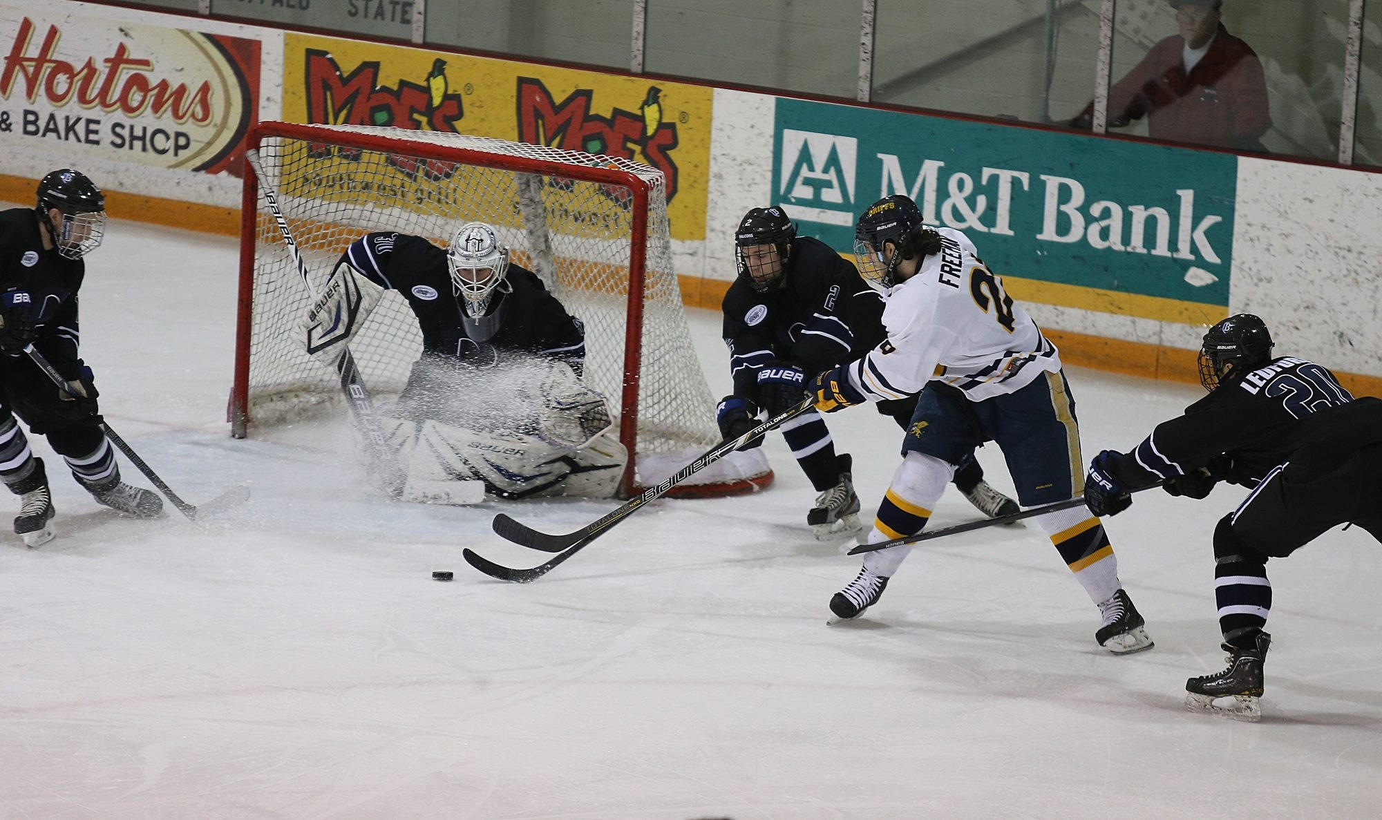 Canisius forward Cody Freeman gets a shot off against Bentley goalie Branden Komm and defenseman Matt Maher at Buffalo State College on Sunday.