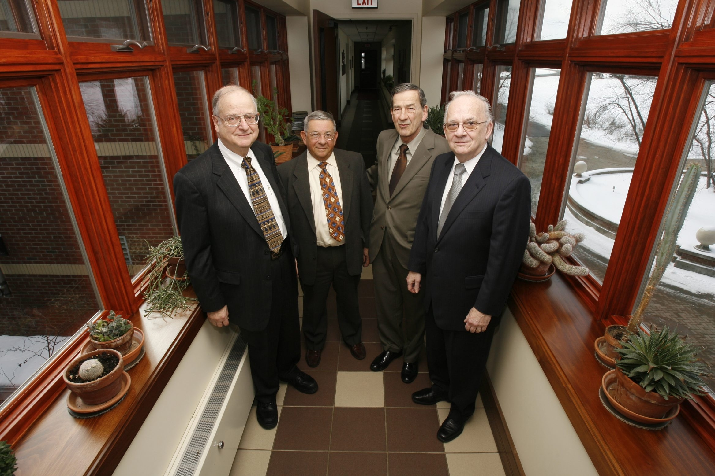 Pictured in happier times, the relationship between Ecology & Environment's four co-founders crumbled last year with the ouster of the late Gerhard J. Neumaier, left, as E&E's chairman by his longtime partners, Ronald L. Frank, Frank Silvestro and Gerald A.Q. Strobel.