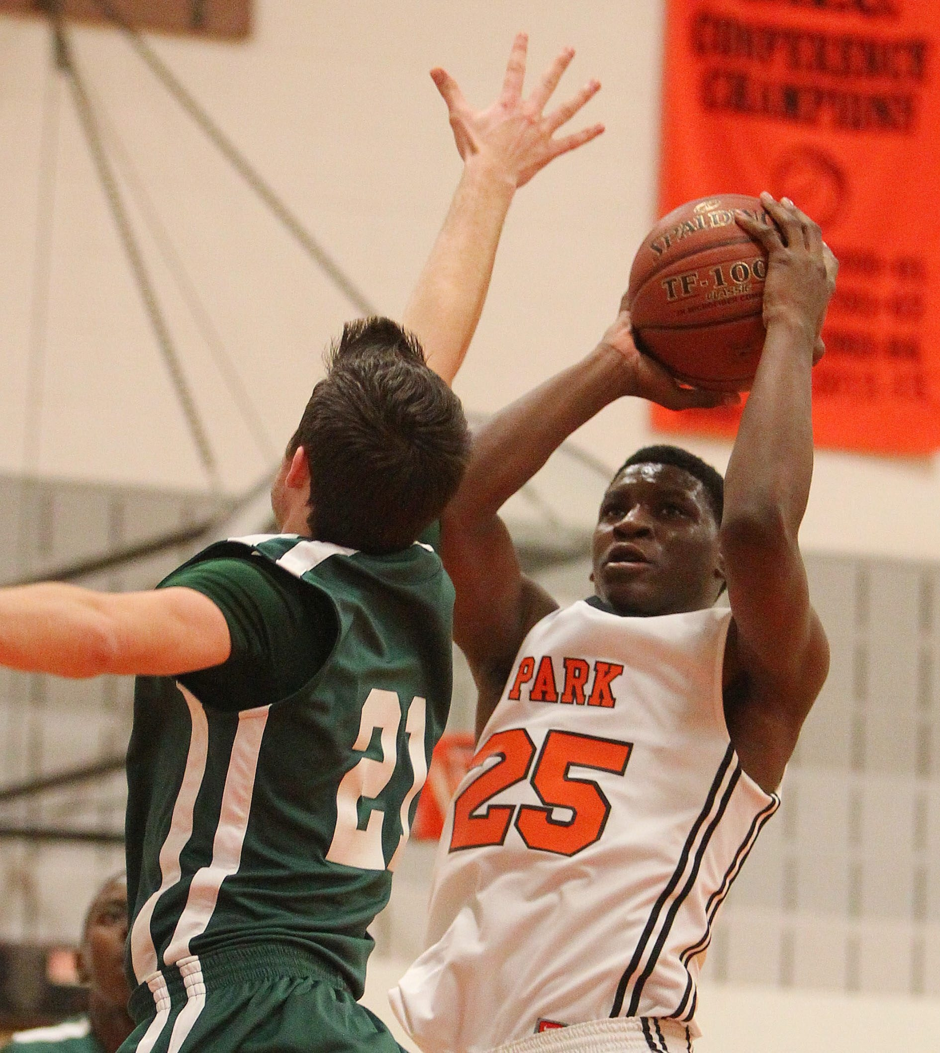 Park's Fred Foster lifts a shot over Nichols' Tom Nuttle in the first half of their game at Park on Friday night.