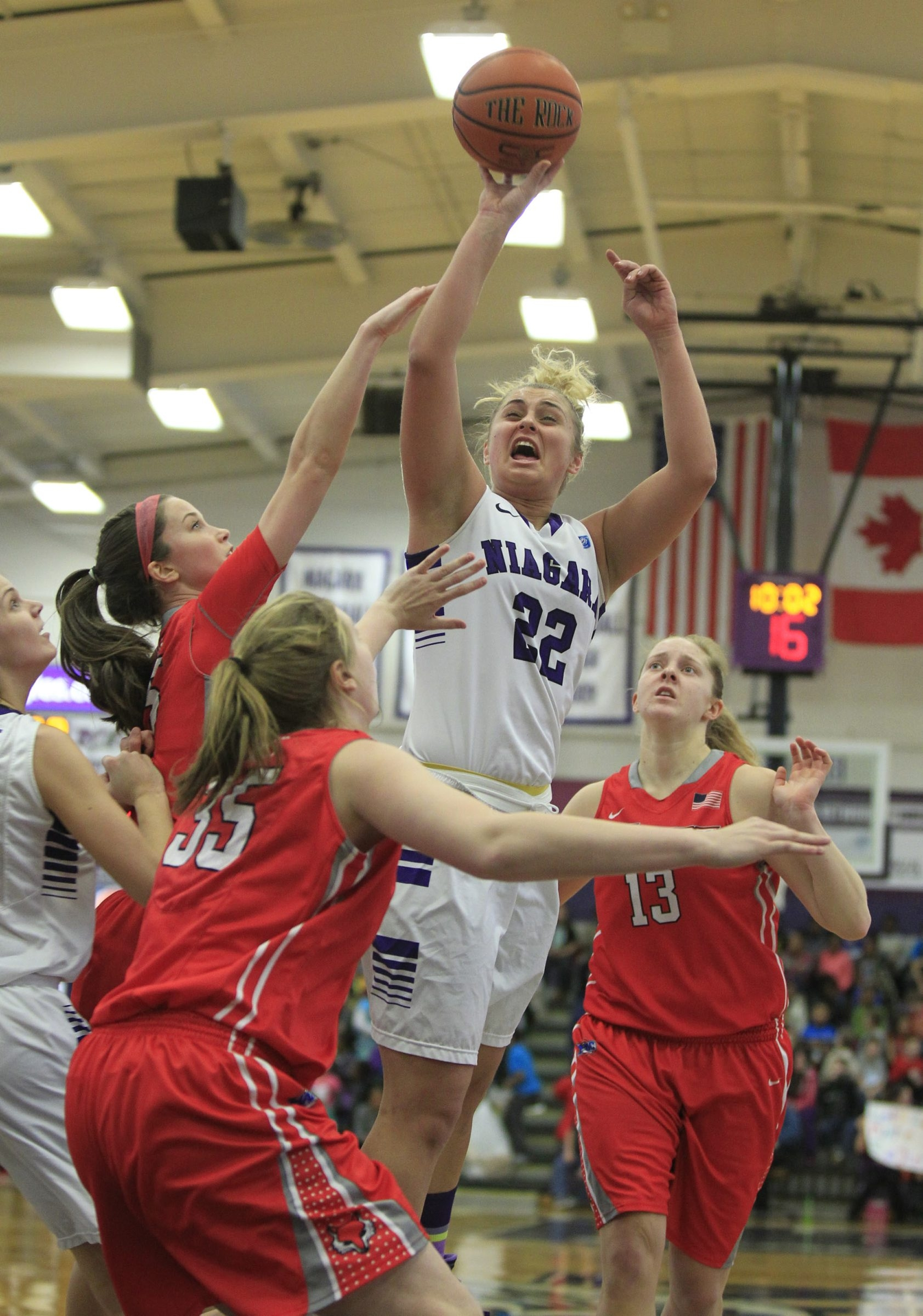 The Marist Red Foxes surround Niagara's Victoria Rampado during a 74-59 victory during at Niagara on Friday.