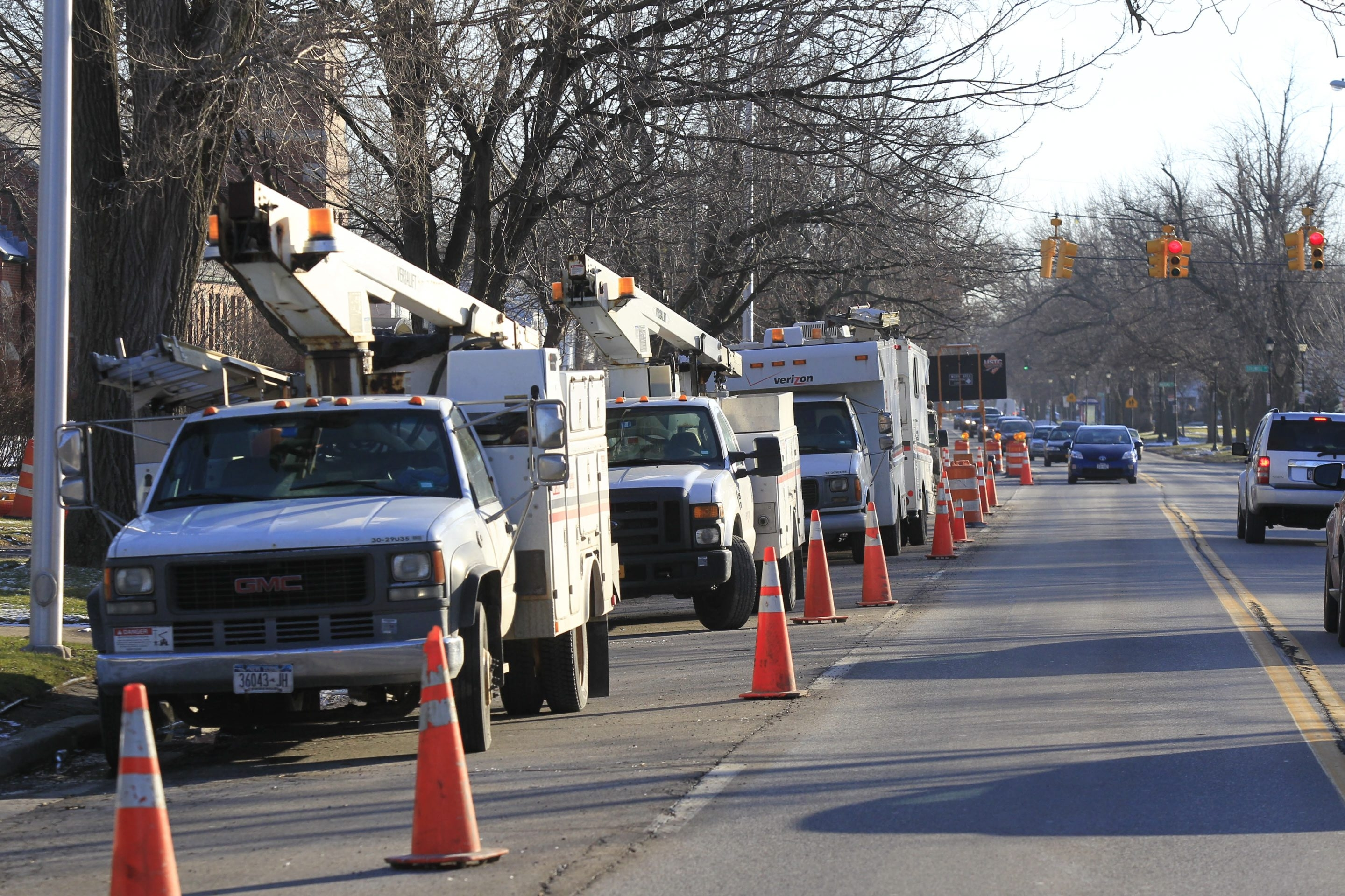 Verizon service trucks line Colvin Boulevard in the Village of Kenmore on Thursday.