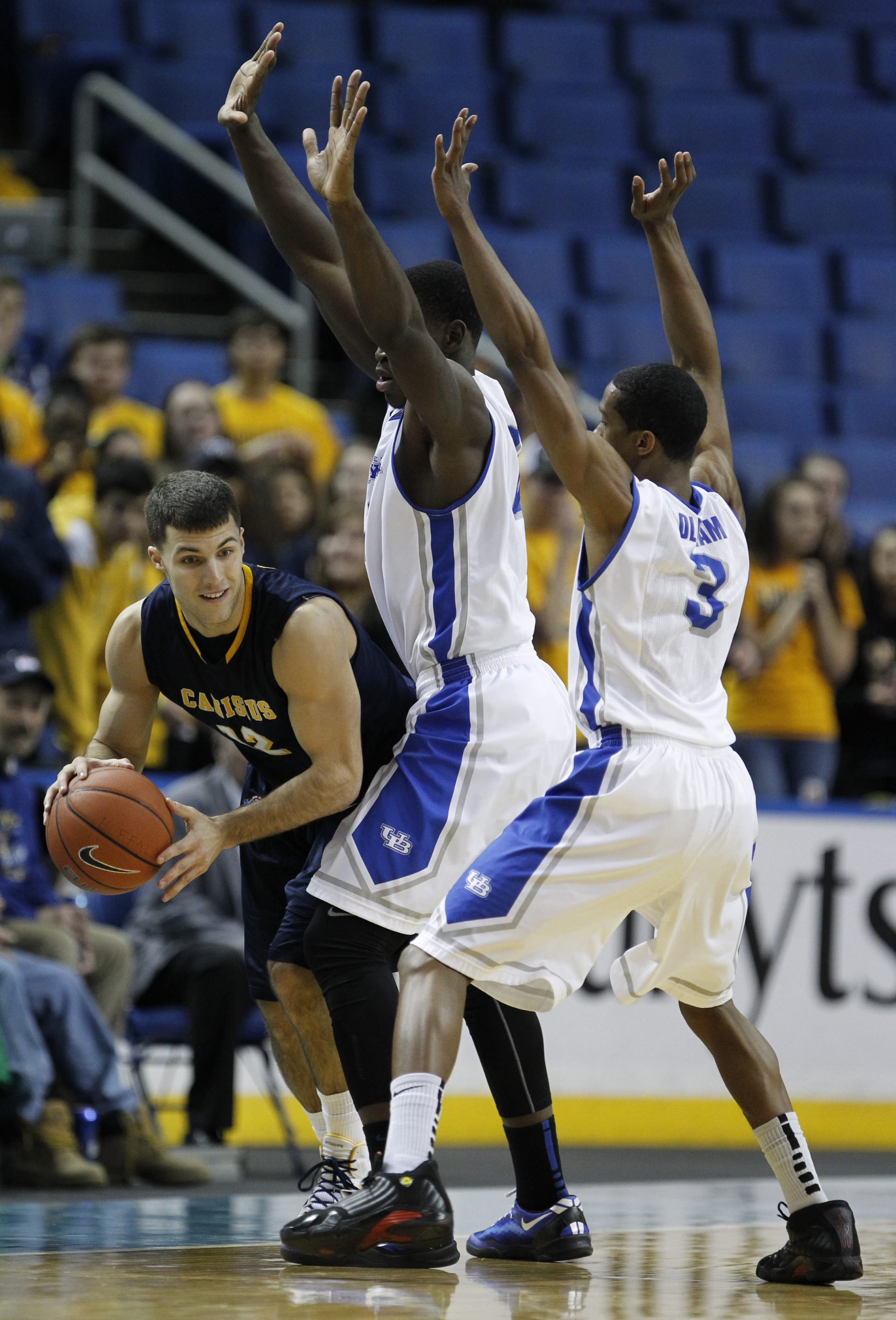 Billy Baron, left, and UB's Javon McCrea and Jarod Oldham (3) have big games this weekend.