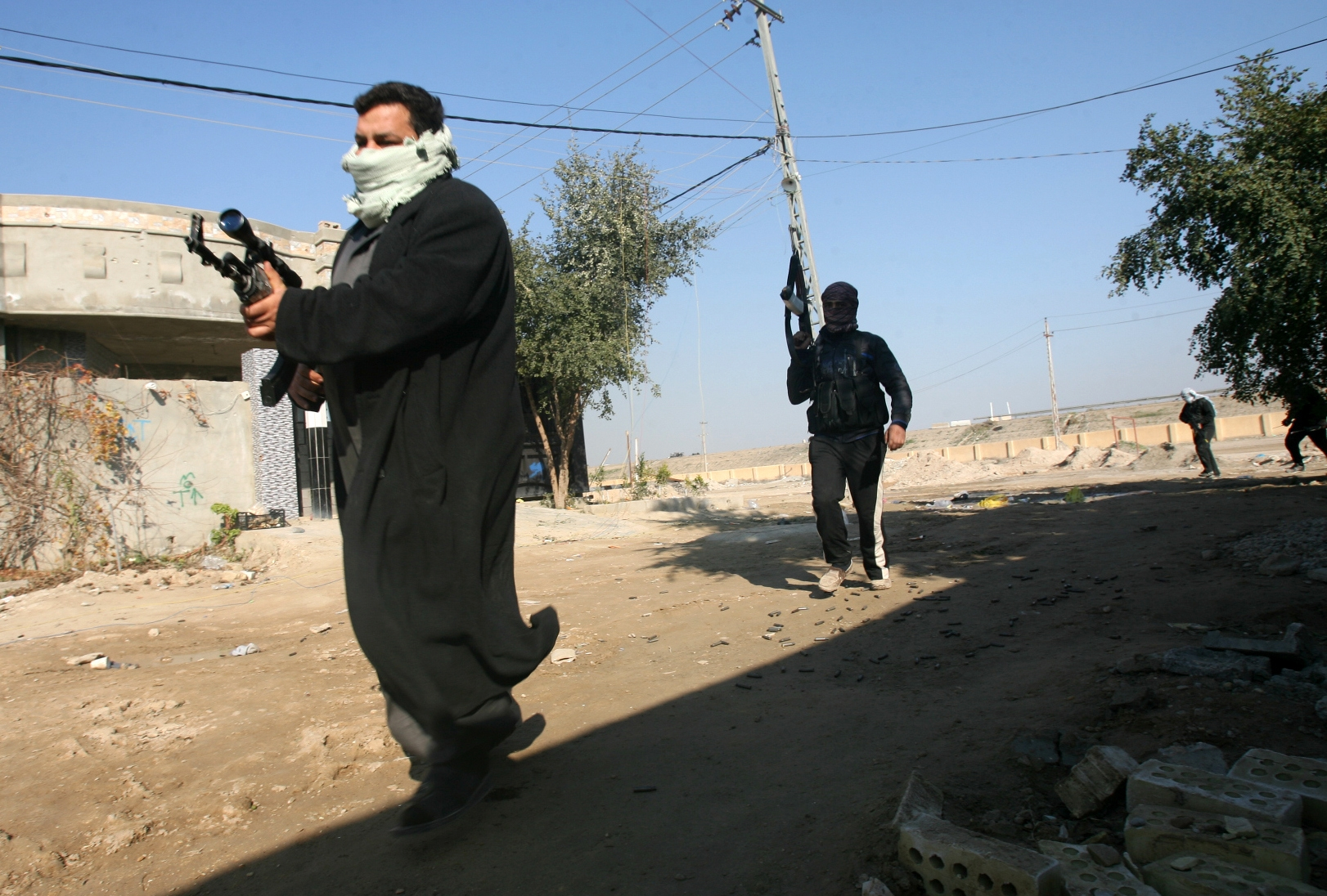Gunmen linked with an al-Qaida affiliate patrol the streets of Fallujah after expelling the government military. (AP photo)