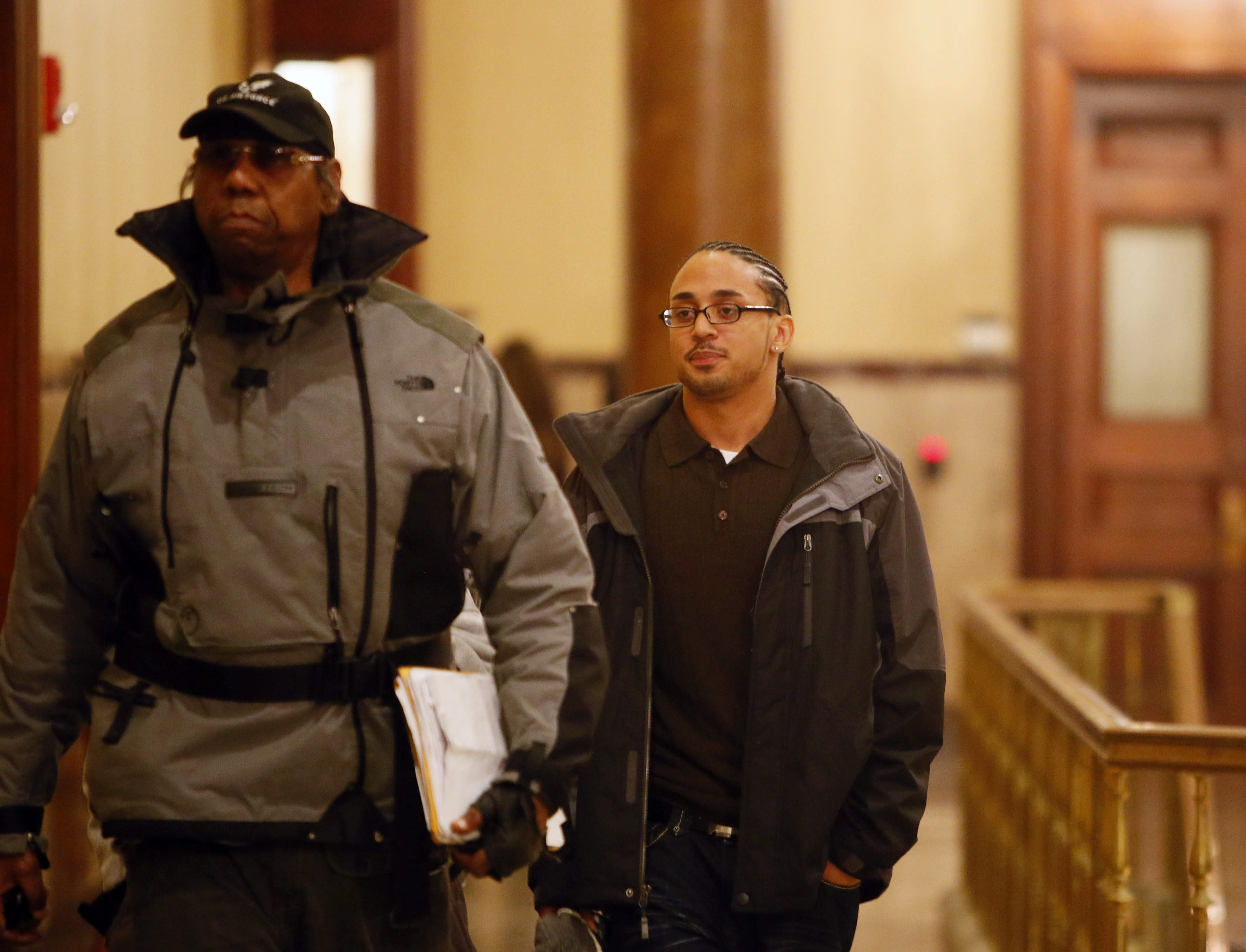 Jerome Thagard, right, leaves the courtroom with Sir Henry Que, the private investigator hired by Thagard's lawyer to work on his case.