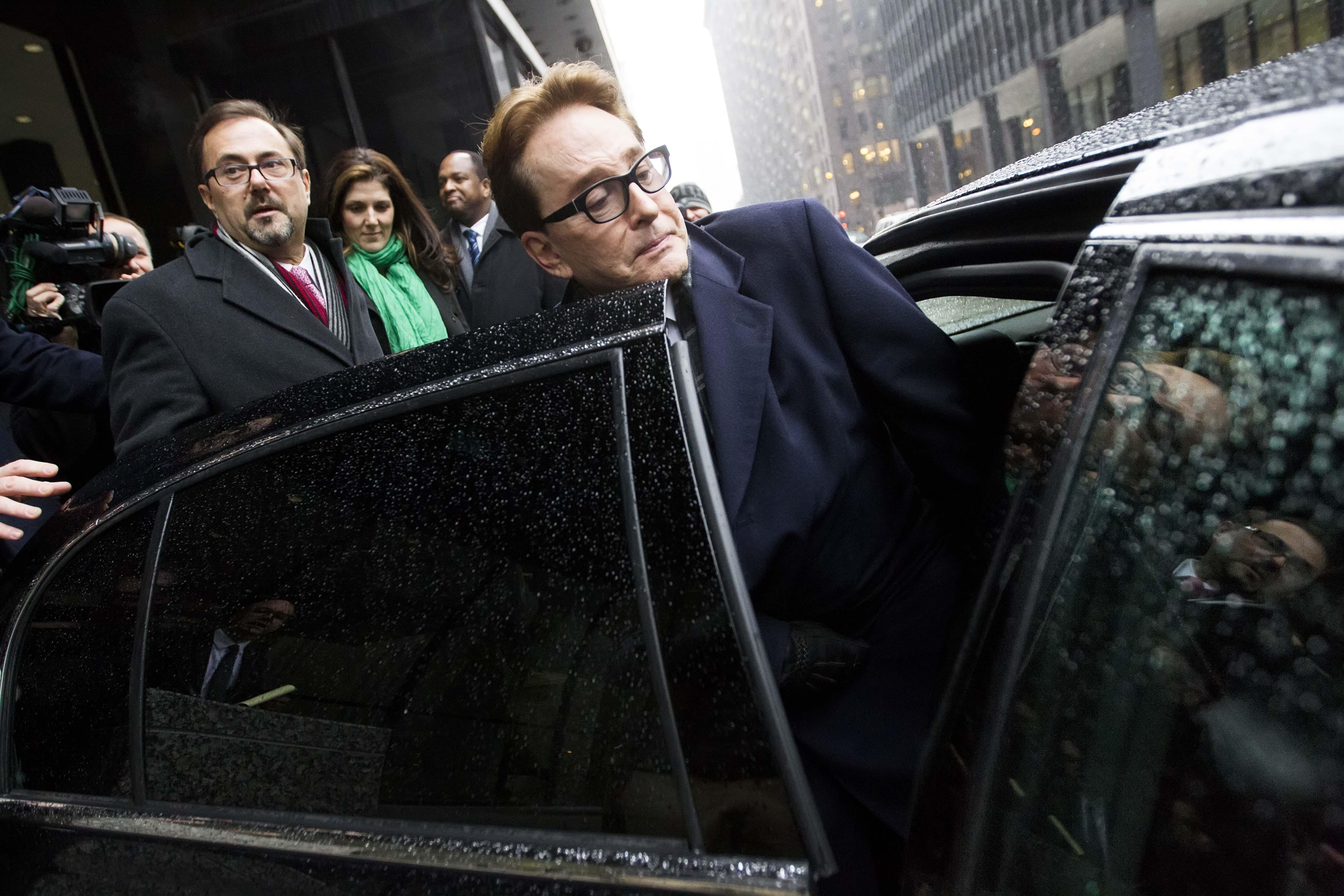 H. Ty Warner, who created Beanie Babies, gets into a car in Chicago Tuesday after being sentenced to probation.