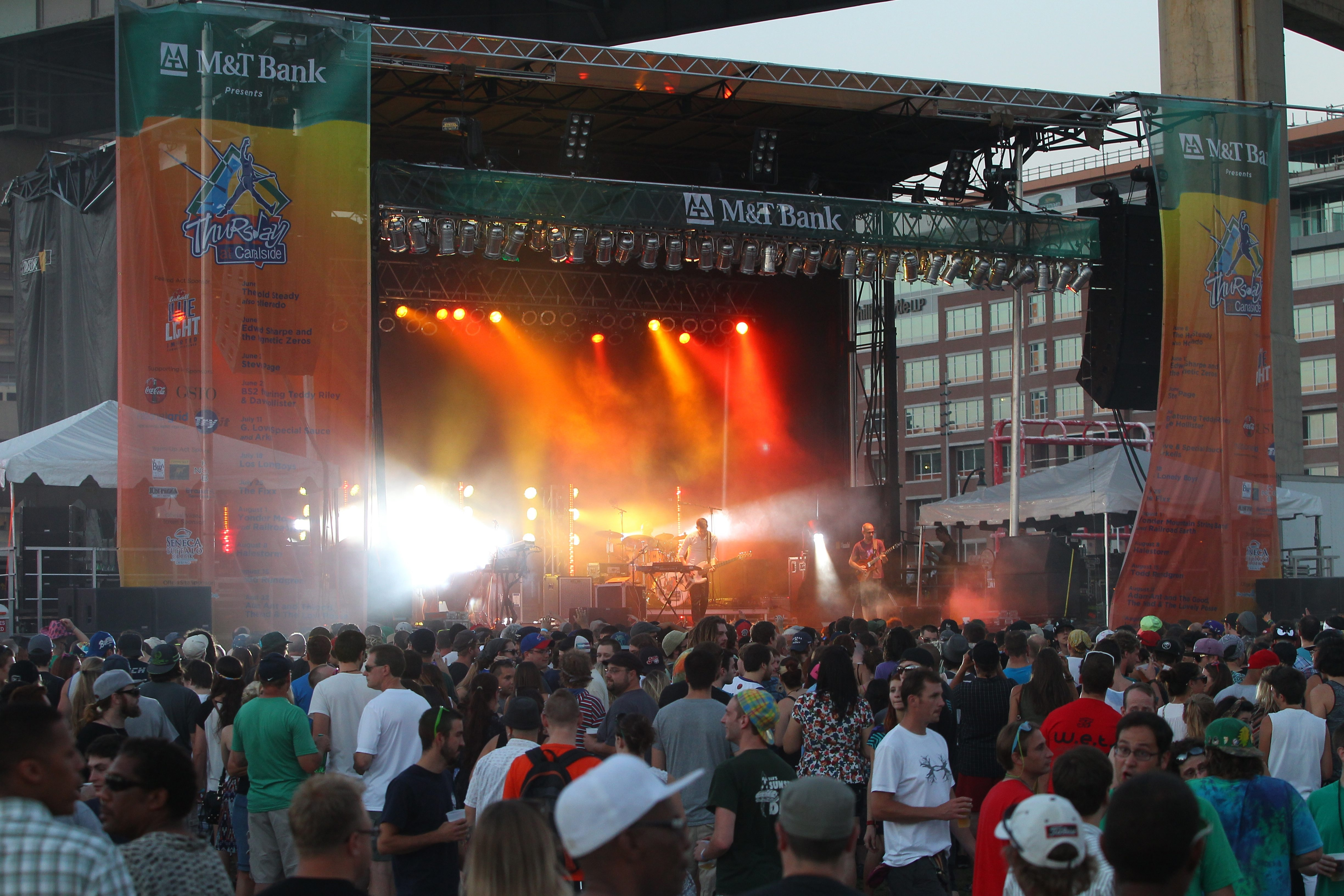The free Canalside concerts, such as this August 2013 performance by Lotus, will continue this summer under the management of Global Spectrum, the new entity selected Monday to operate and program the waterfront venue.