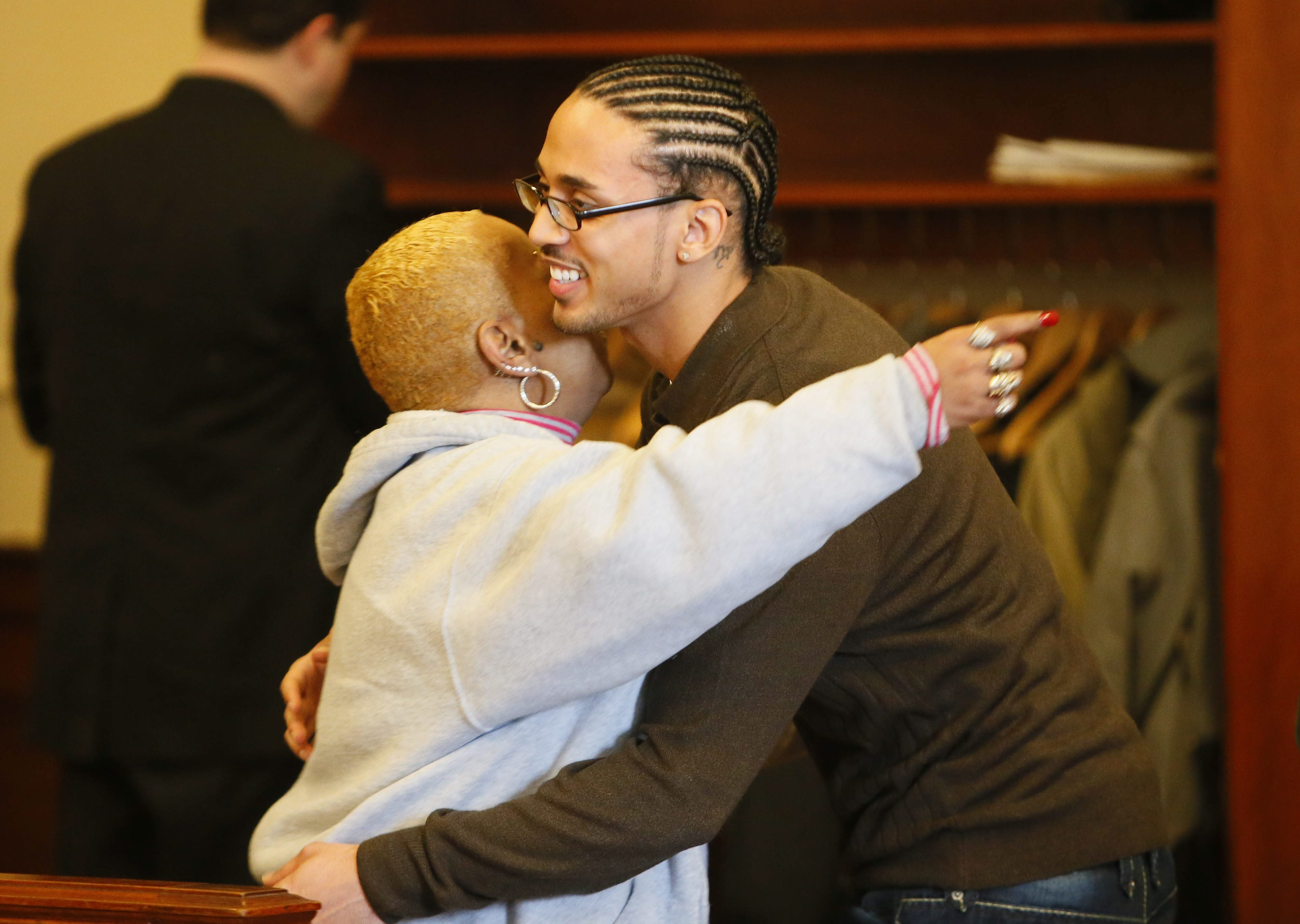 Jerome Thagard hugs a family member inside the courtroom after a murder indictment for which he served prison time was dismissed, Monday, Jan. 13, 2014. (Derek Gee/Buffalo News)
