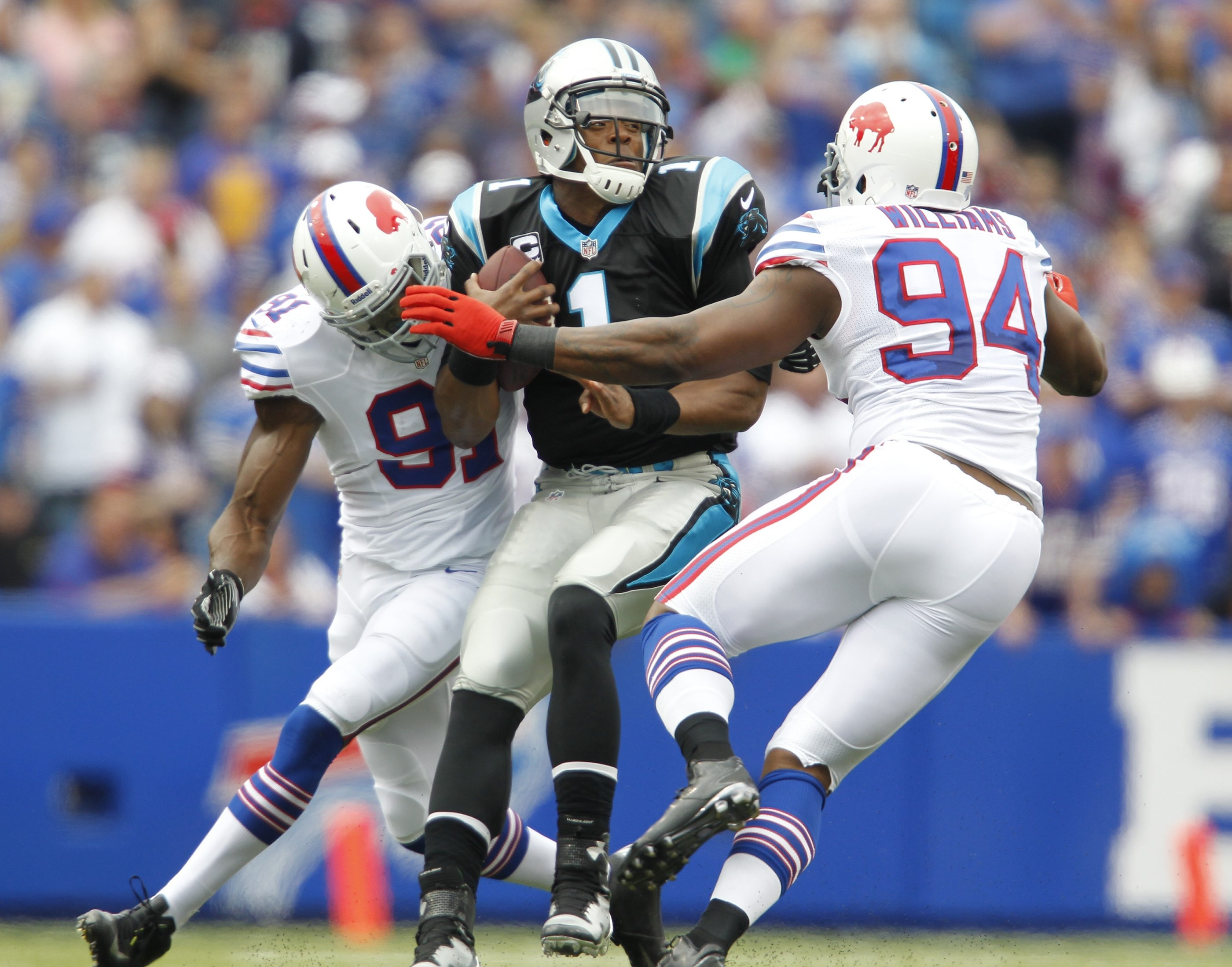 Bills linebacker Manny Lawson, left, and defensive end Mario Williams sack Carolina's Cam Newton at Ralph Wilson Stadium on Sept. 15. The Bills finished second in the league in total sacks.