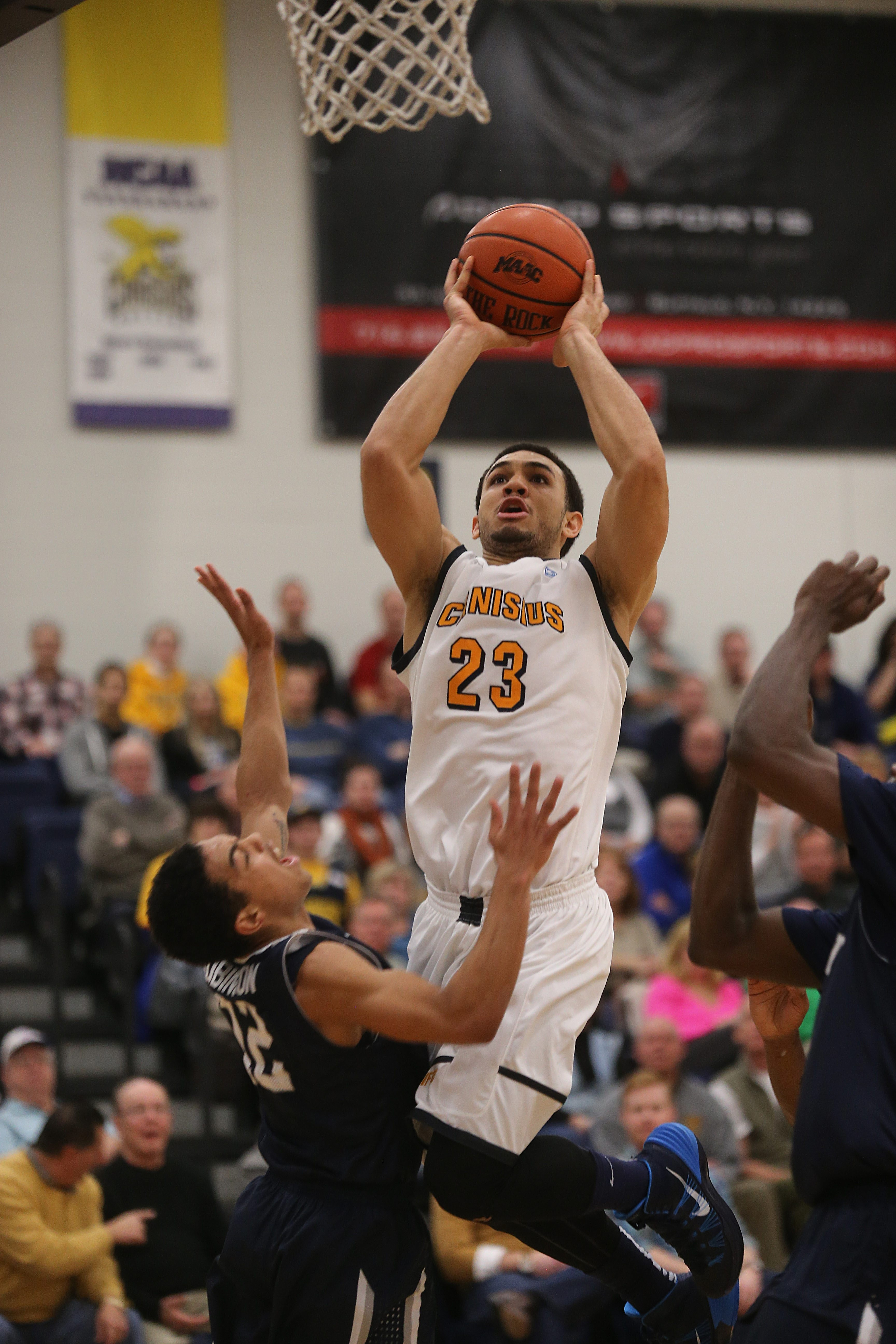 Canisius' Chris Perez drives the lane against Monmouth.