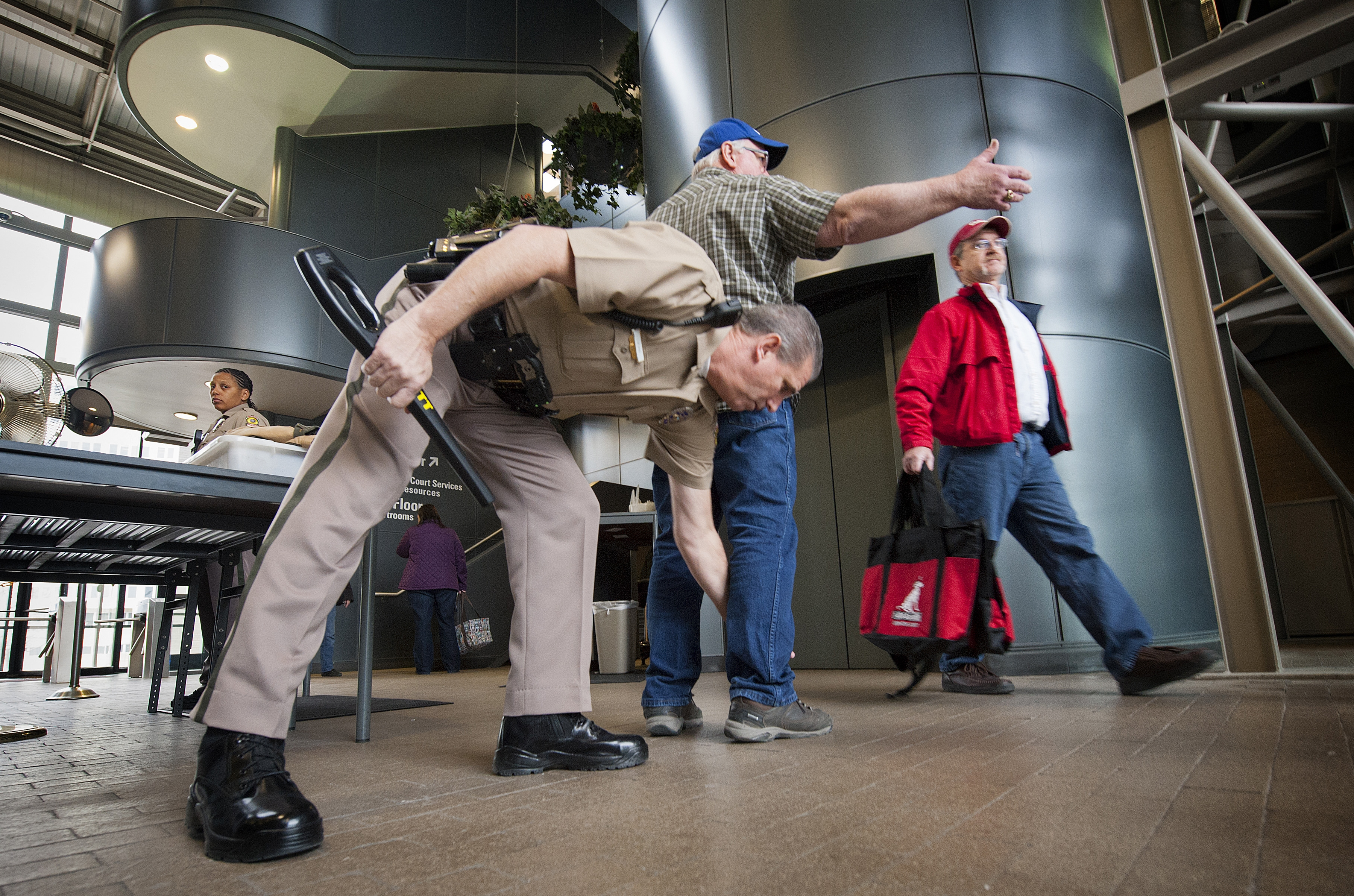 Police officers screen visitors entering City Hall in Wichita, Kan. It is one of the few public buildings in the city that bans concealed weapons, complying with a new ordinance.