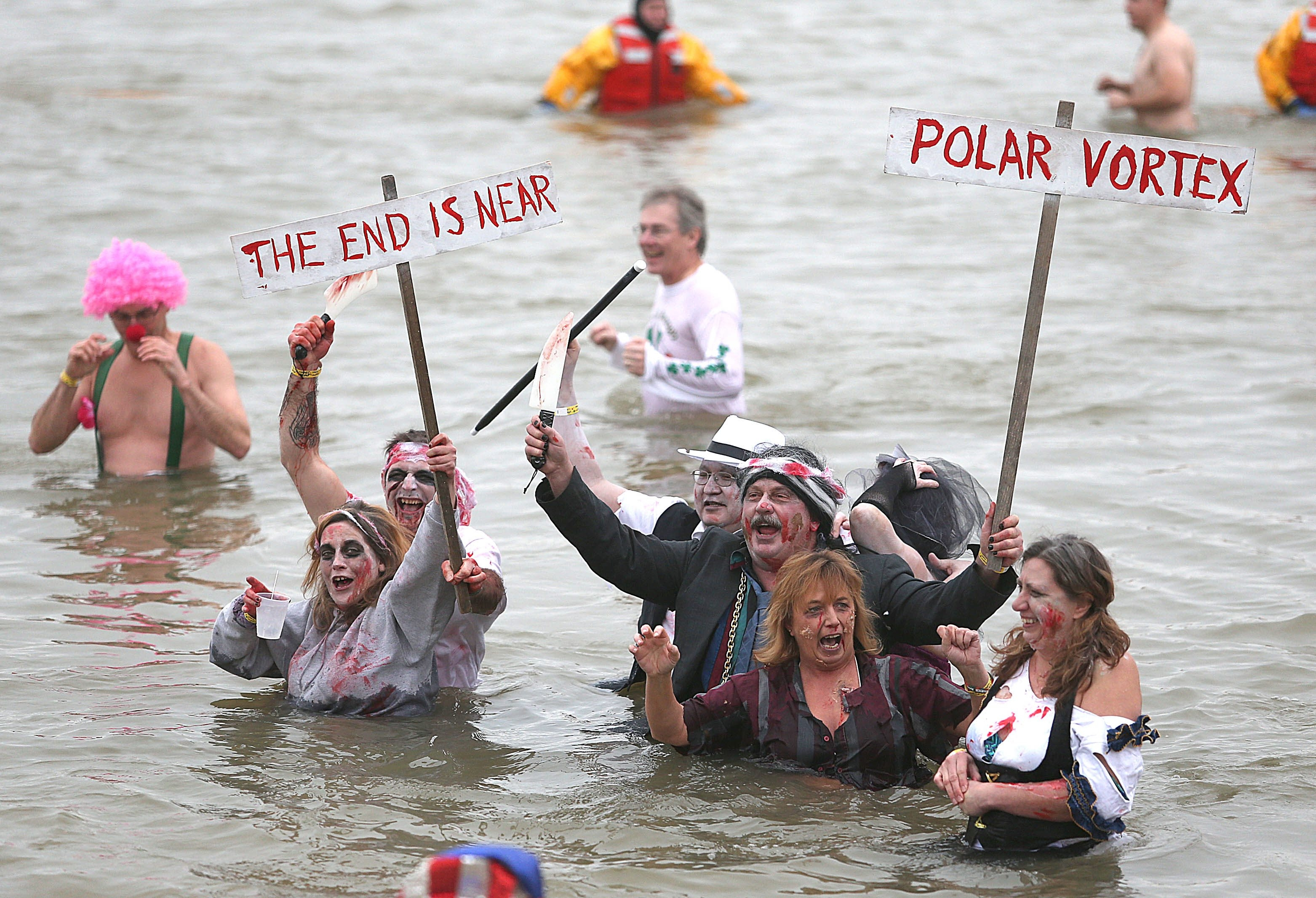 Participants in the Silver Creek Polar Bear Swim frolic in the frigid waters near the Jackson Street beach on Sunday. About 100 swimmers took the plunge this year.