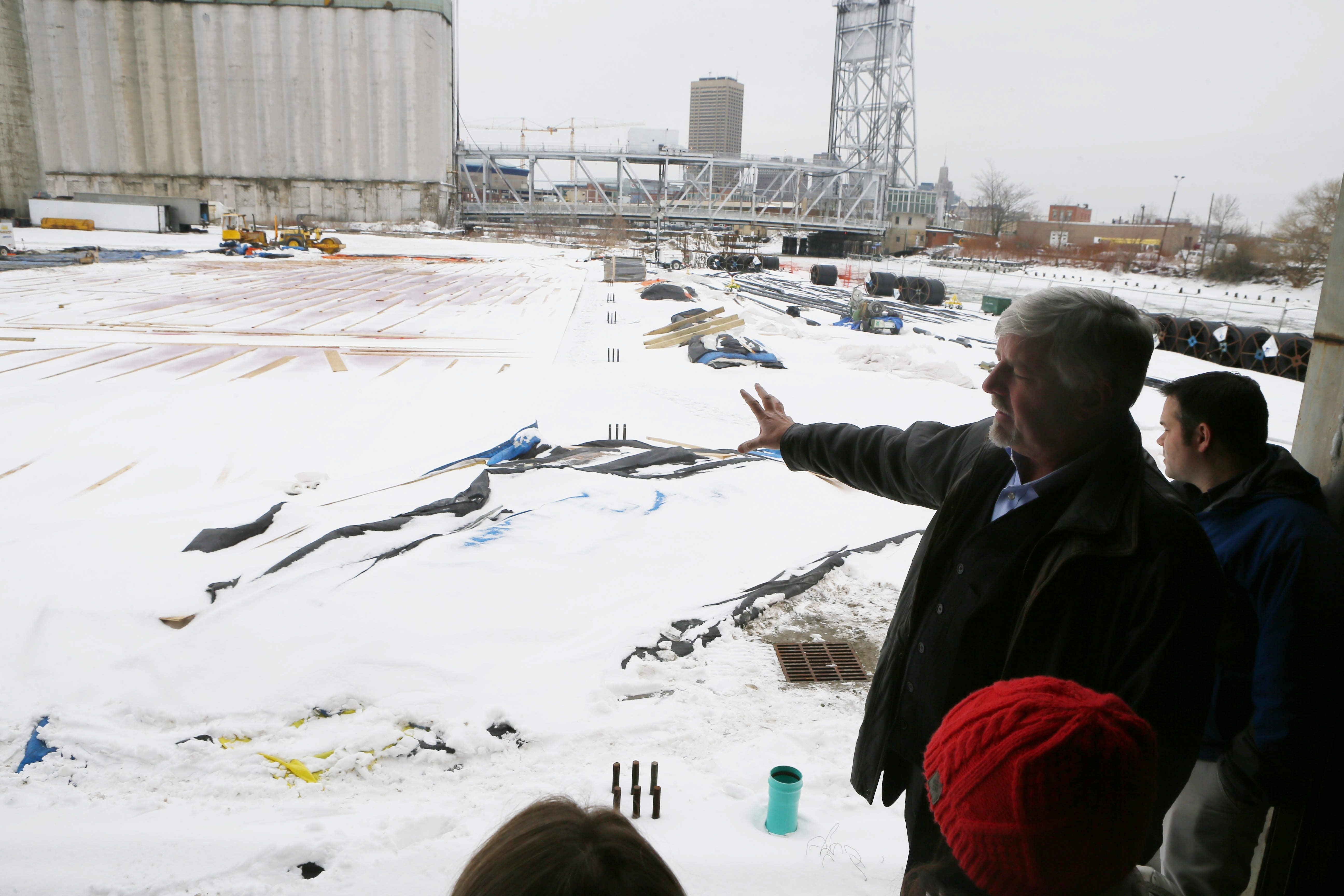 Developer Doug Swift gives a tour of the Buffalo RiverWorks site to organizers of the Labatt Blue Pond Hockey Tournament on Friday.  The Common Council approved the refrigerated rinks, and the tournament is scheduled for Feb. 21-22.