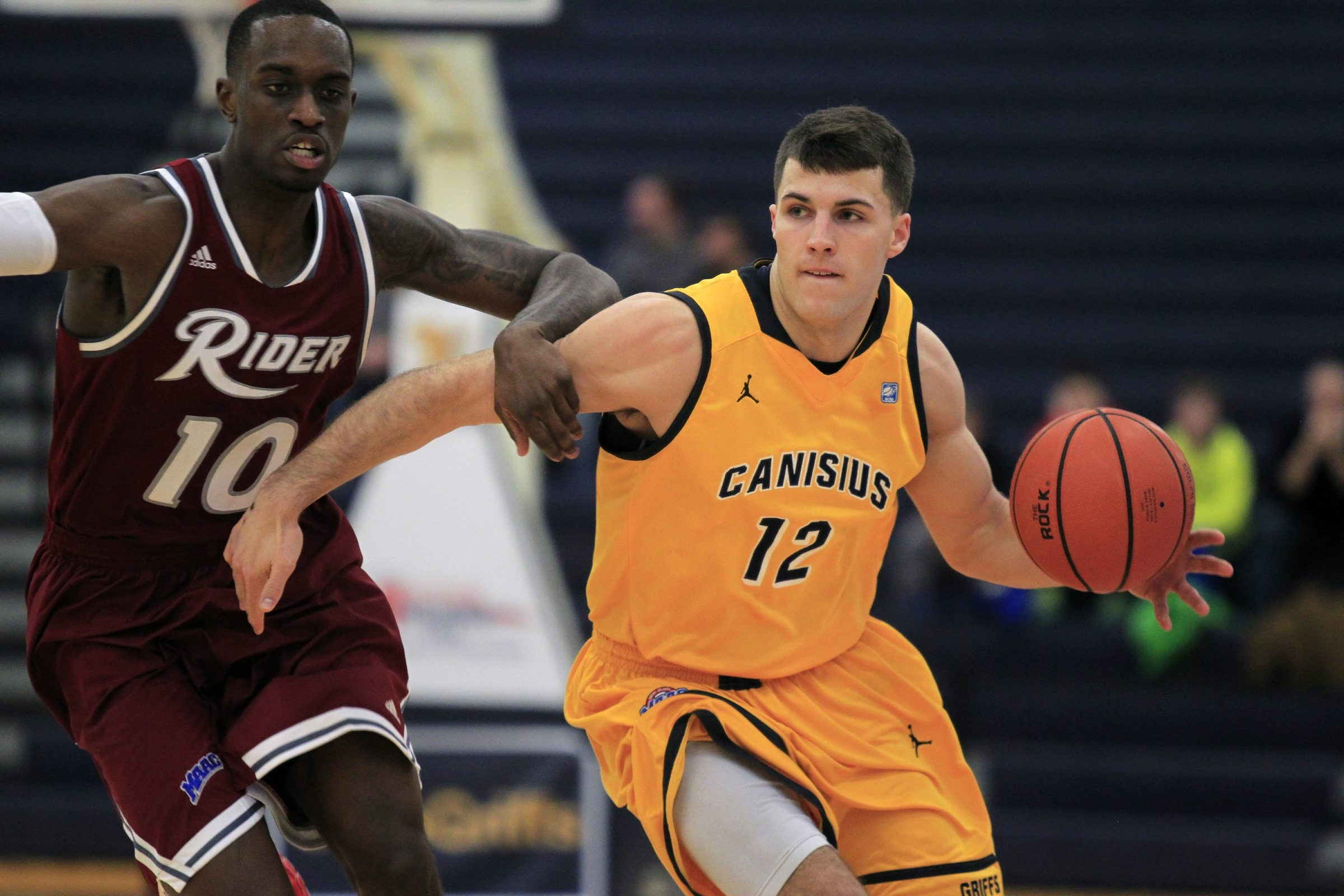 Billy Baron of Canisius dribbles past Rider's Anthony Myles Friday. For a photo gallery from the game, go to BuffaloNews.com.