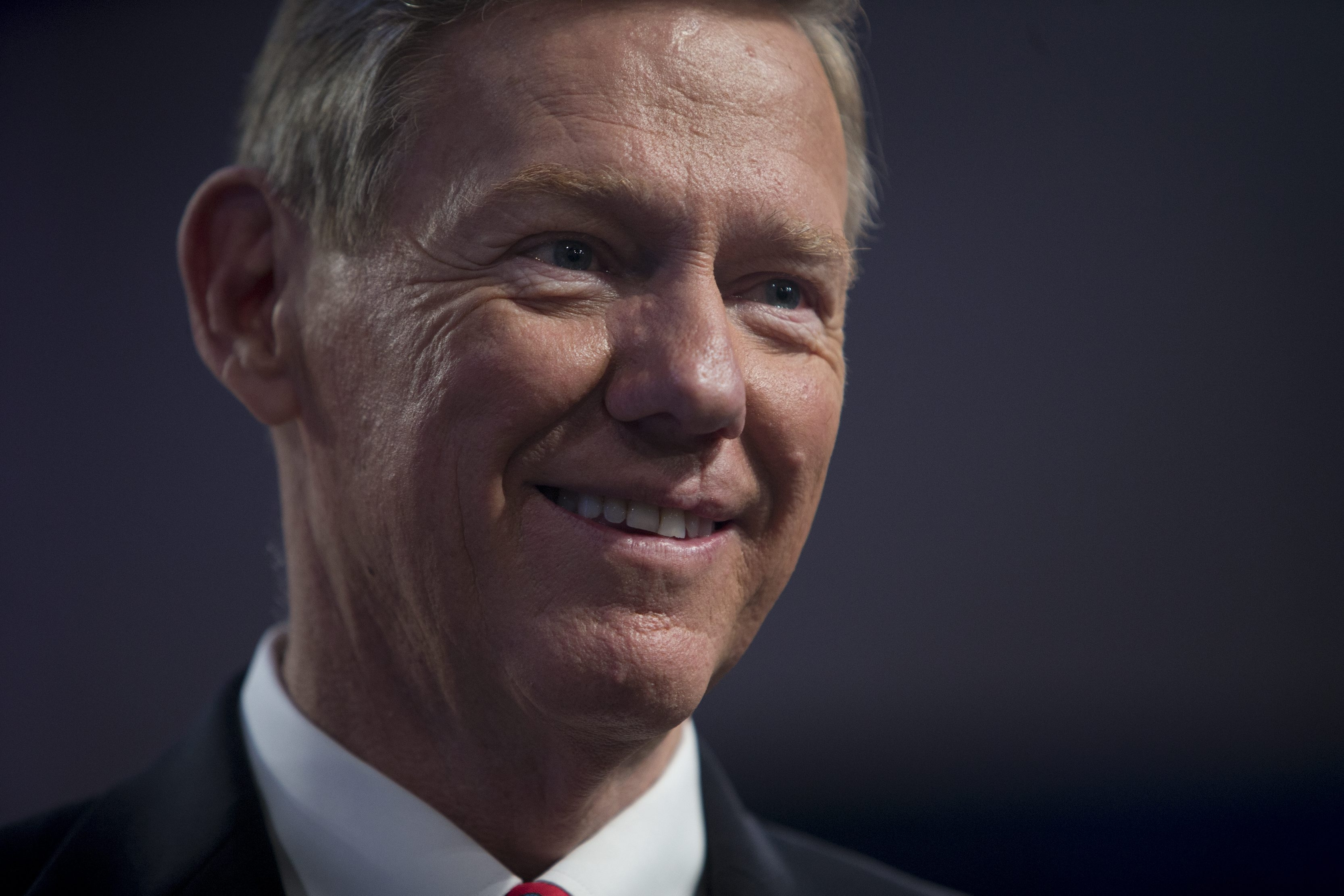 Alan Mulally will stay with Ford through 2014.