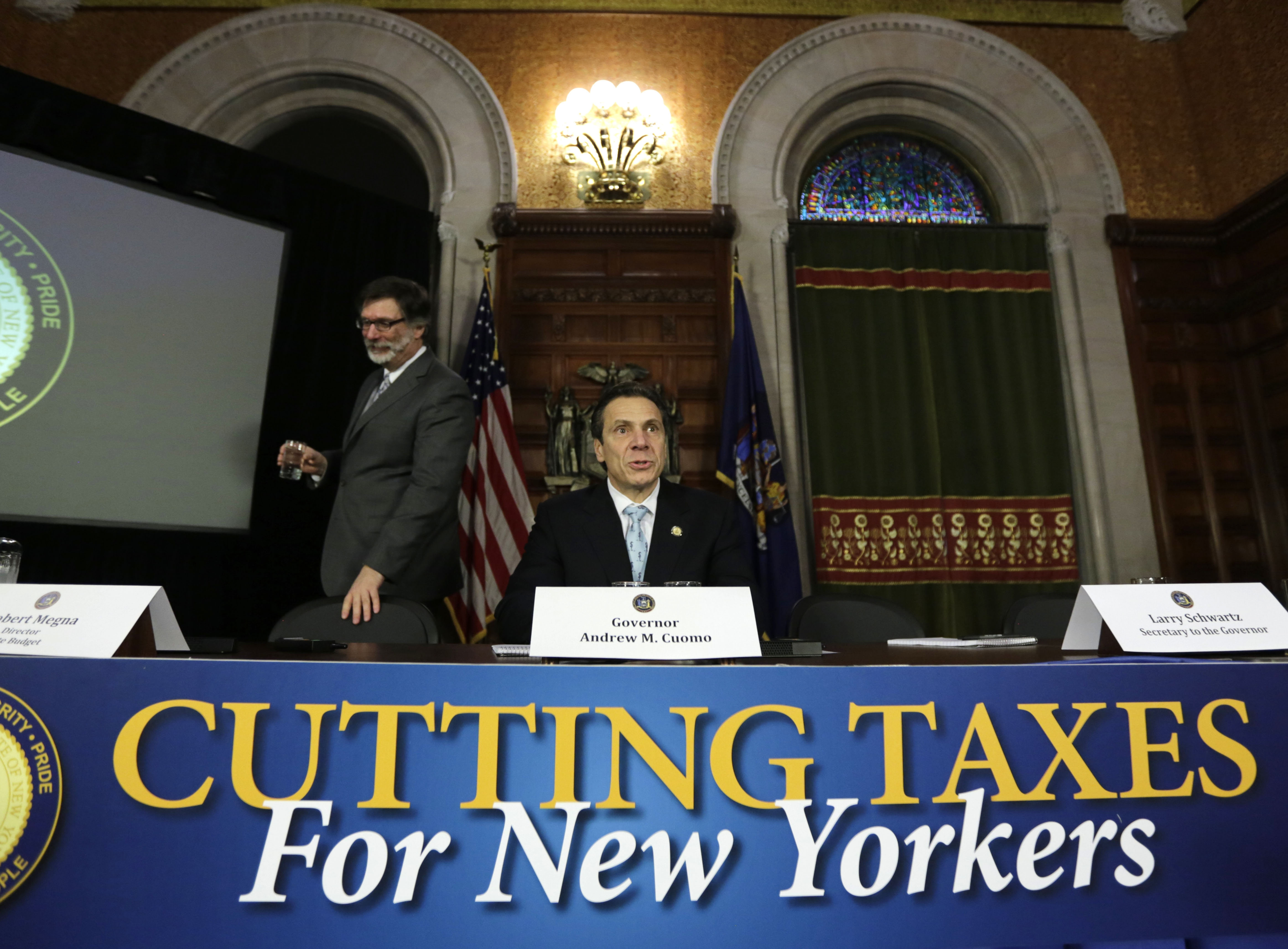 In advance of Wednesday's State of the State address, Gov. Andrew Cuomo announces his tax relief plan. In addition to a property tax freeze, Cuomo wants to cut the state's corporate income tax from 7.1 percent to 6.5 percent and eliminate it altogether for upstate manufacturers. (Associated Press)