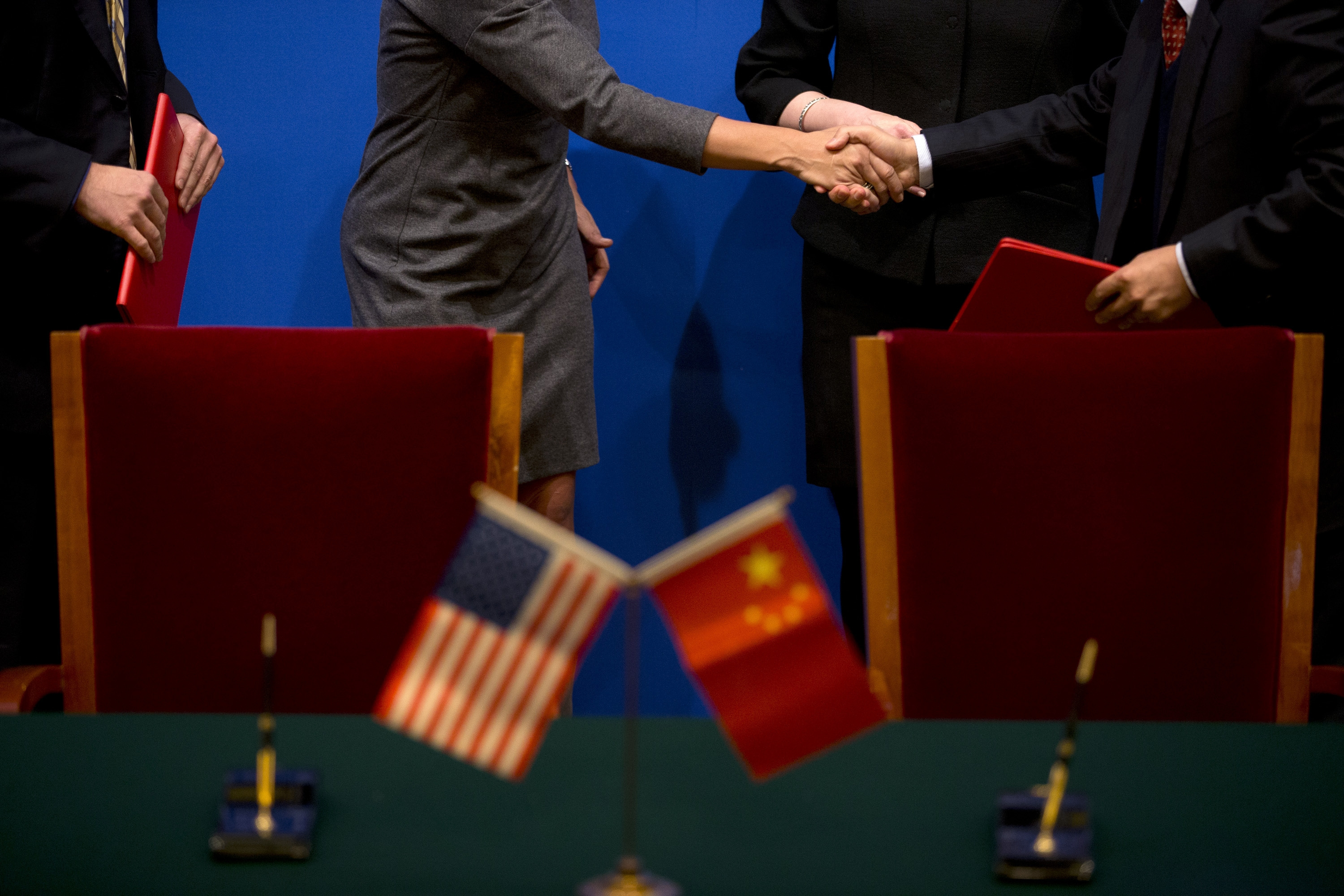 U.S. Secretary of Commerce Penny Pritzker, second from left, shakes hands with a Chinese company executive after a cooperative agreement was signed between the company and an American company at the 24th China-U.S. Joint Commission on Commerce and Trade held at Diaoyutai State Guesthouse in Beijing, Friday, Dec. 20, 2013. (AP Photo/Alexander F. Yuan, Pool)