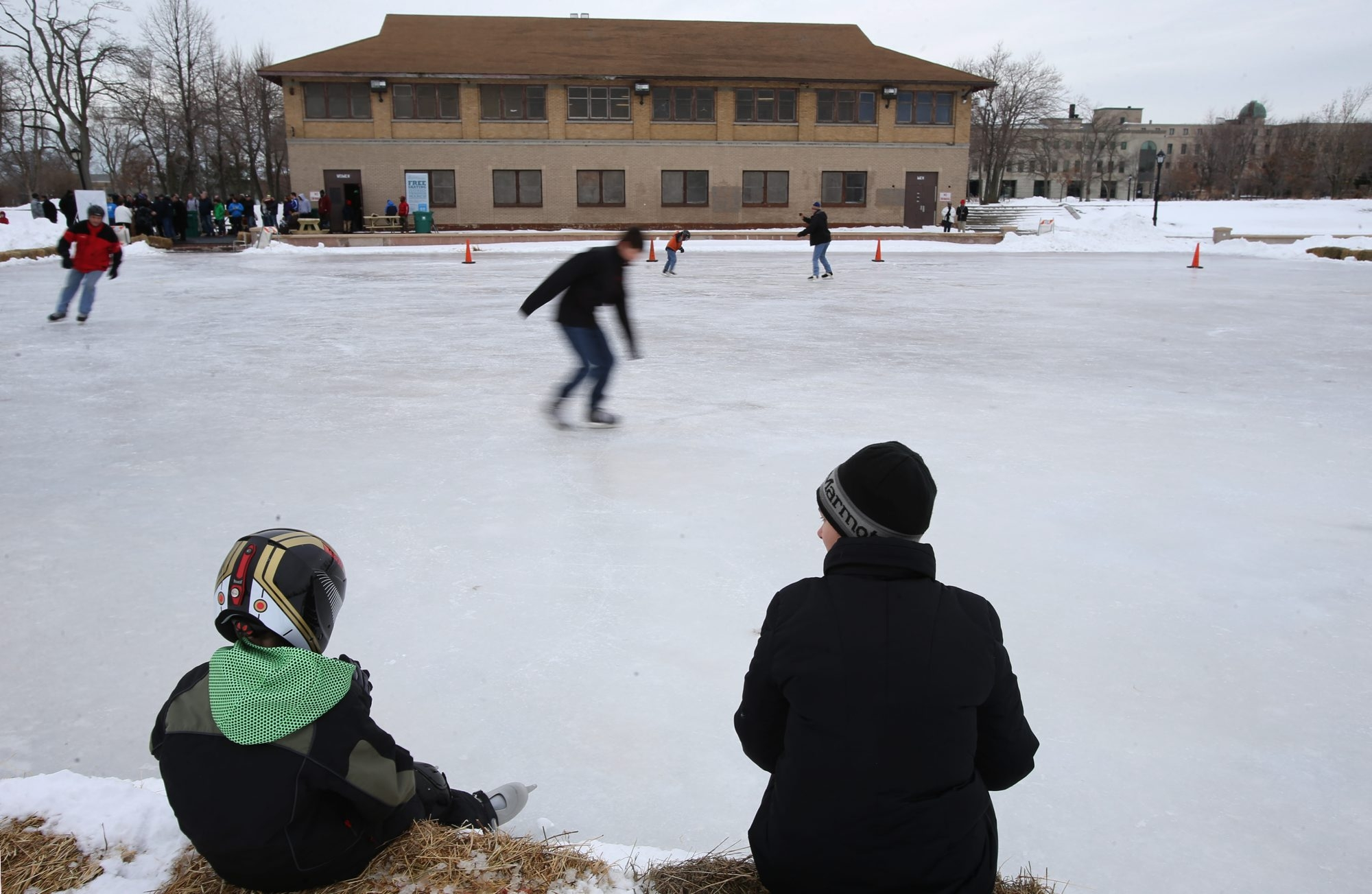 Kristin Merlo, of Buffalo, and her son Patrick, 9,  watch the skaters on the ice rink at Martin Luther King Park in Buffalo on Sunday.
