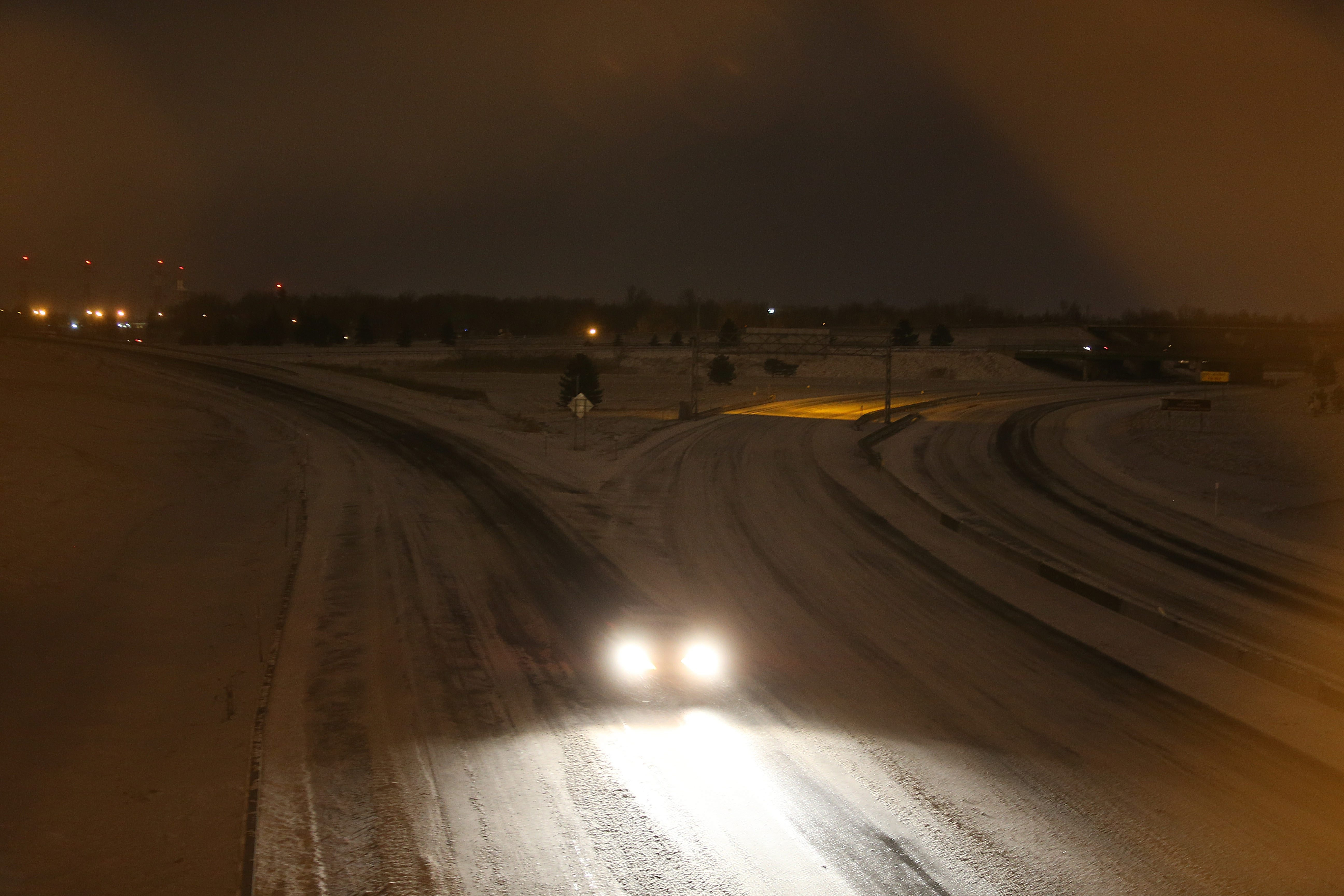 A sole vehicle merges onto the I-90 Thruway from the I-290, after the Thruway was closed at 8 p.m., Friday, January 6, 2014. (Charles Lewis/Buffalo News)