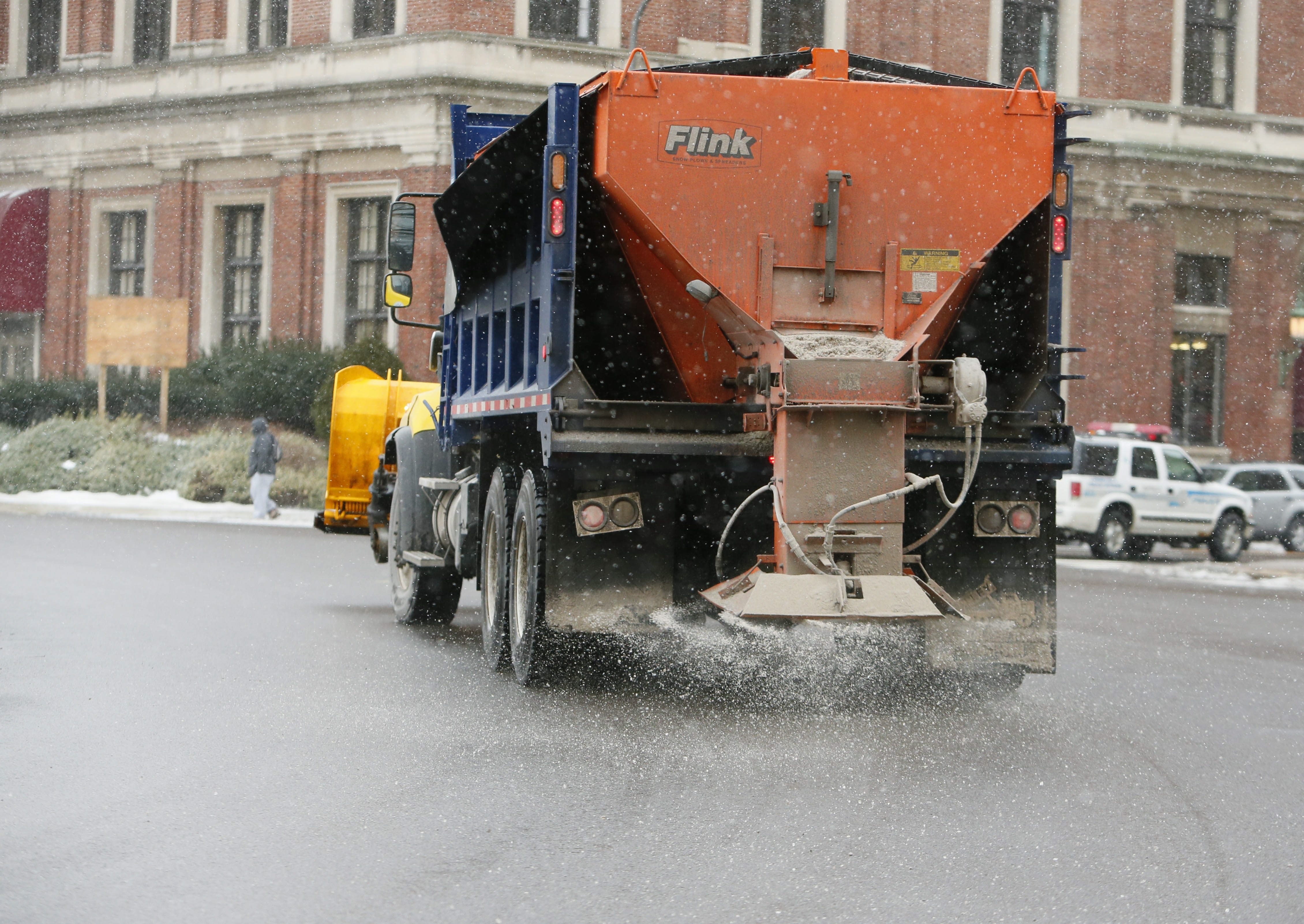 A City of Buffalo plow disperses salt on the road in Niagara Square in preparation for the impending storm today. Some areas could get as much as 2 to 3 feet of snow by Wednesday morning.