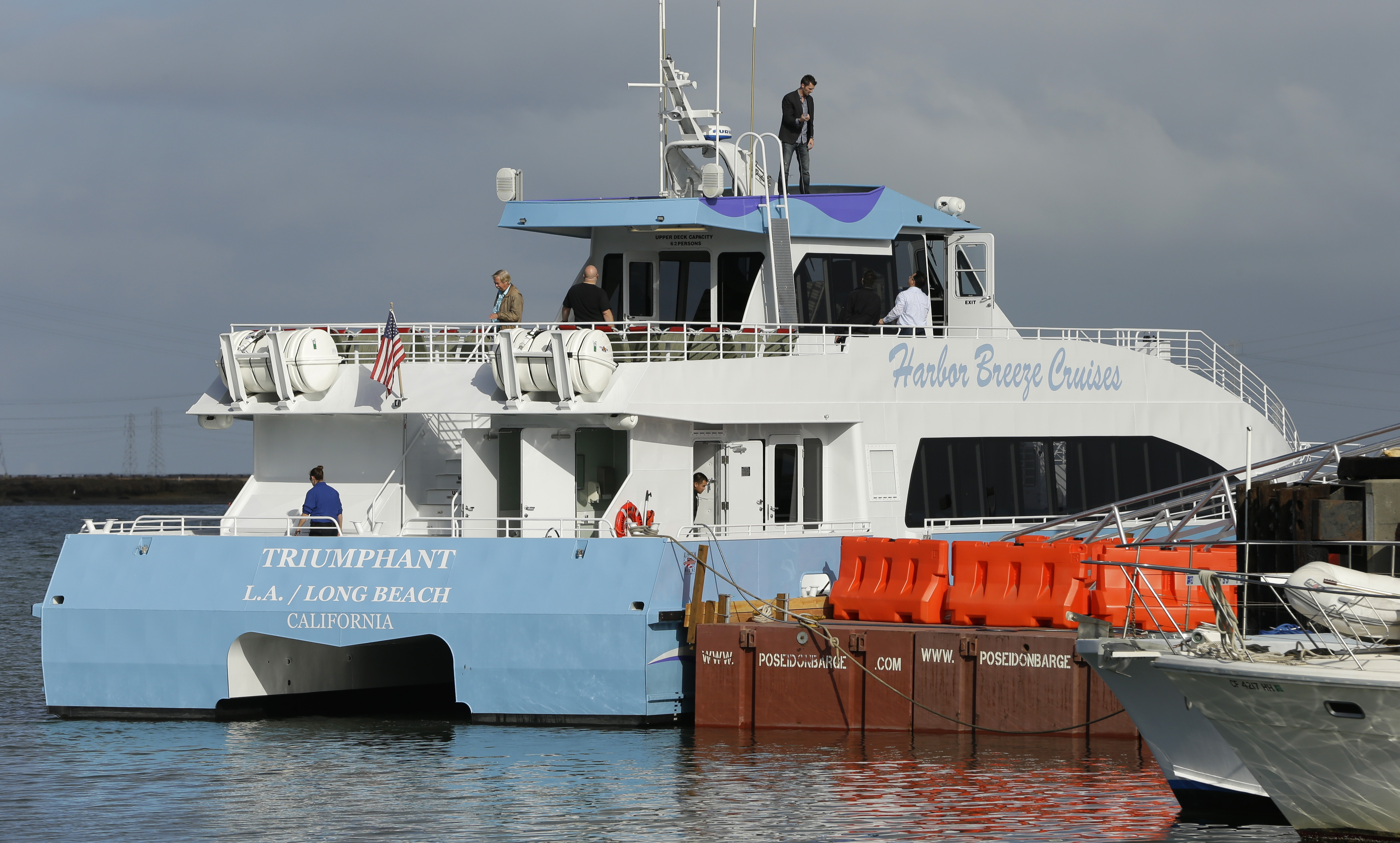 Commuters board a catamaran serving as a ferry for Google employees Thursday in Redwood City, Calif. The vessels ferries workers to and from San Francisco.