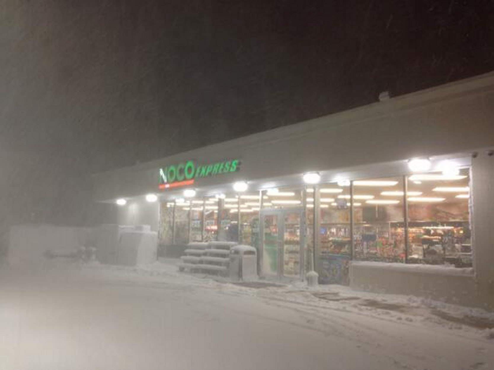 The scene around 3:30 a.m. at the Noco Express on South Park Avenue.