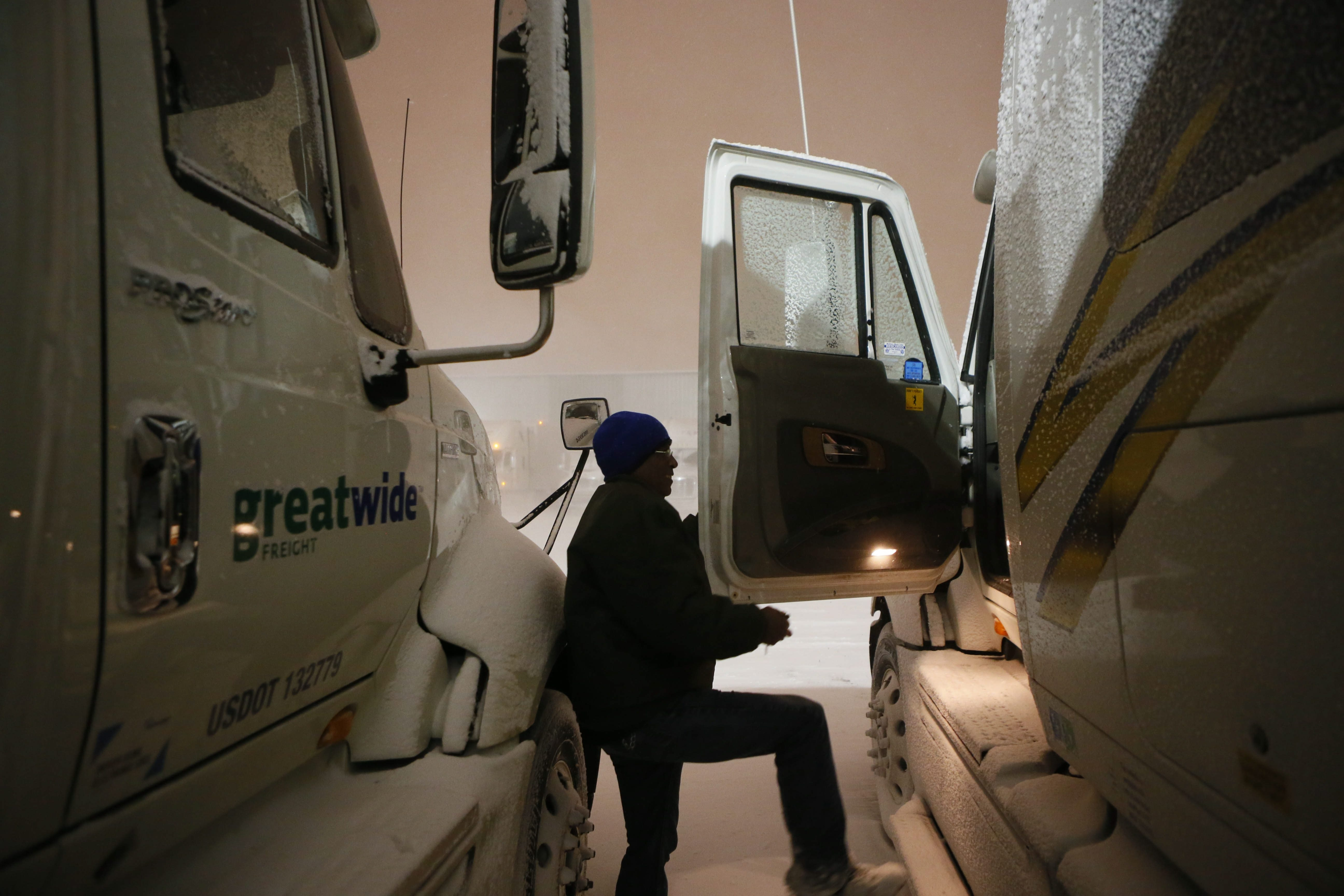 Martin Parker, of Columbus, Ohio, climbs into his rig at Jim's Truck Stop on Walden Avenue in Cheektowaga on Monday.