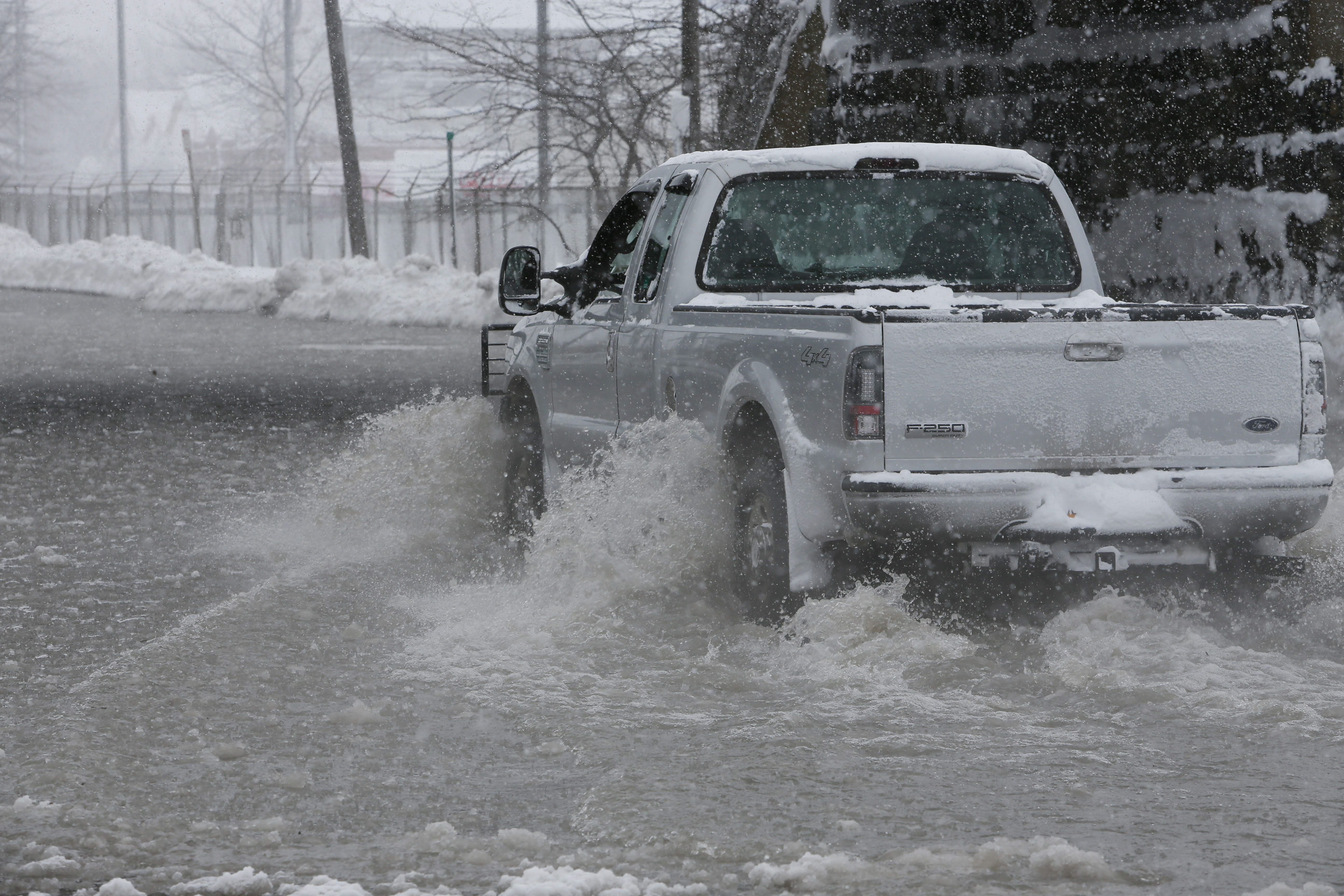 A truck passes through standing water on Route 5 near the former Bethlehem Steel plant in Lackawanna on Wednesday.