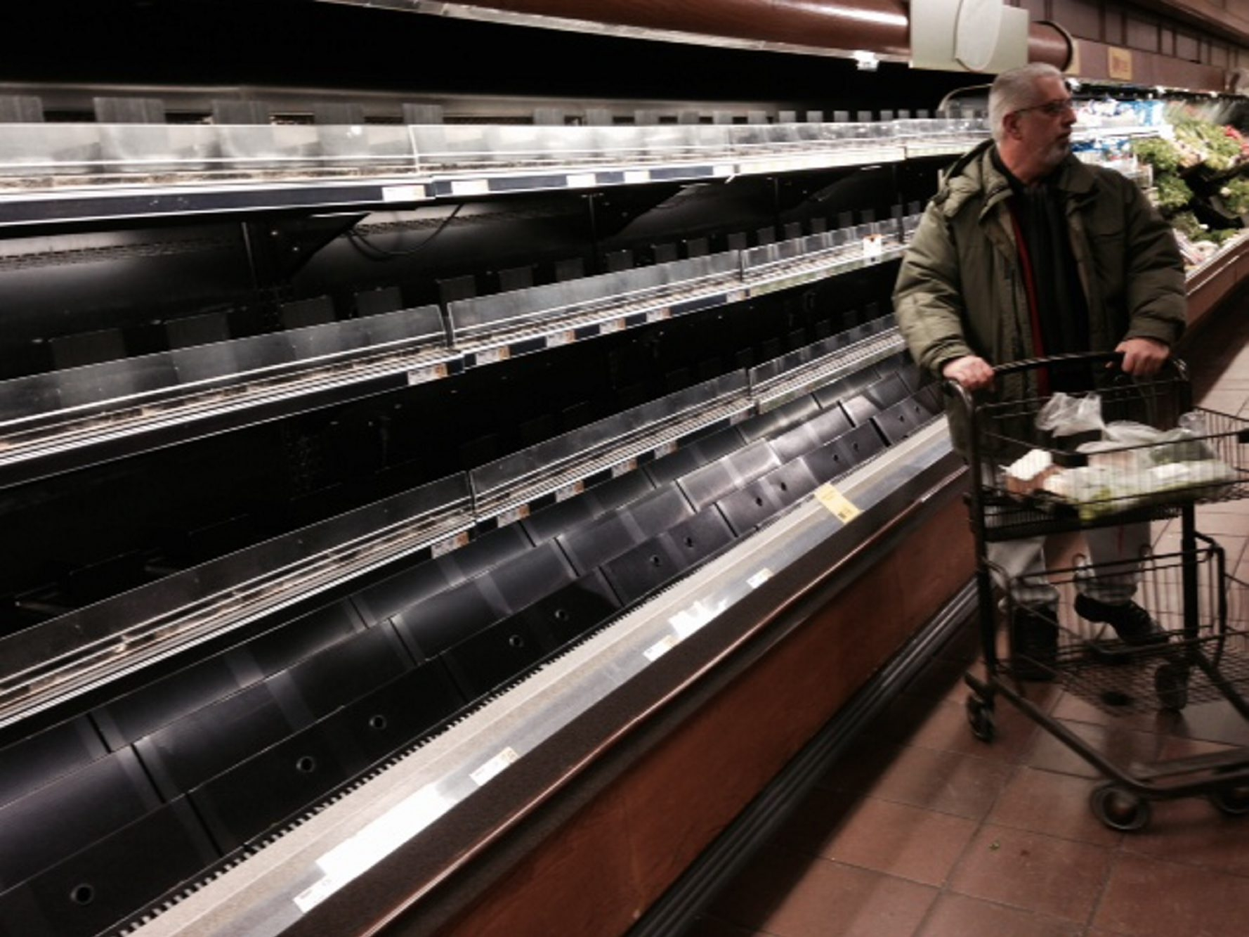 Shelves normally stocked with fresh salads are empty at Wegmans on Amherst Street in Buffalo after storms in the Midwest  interrupted delivery schedules and shoppers stocking up in preparation for the arrival of the storm locally descended.