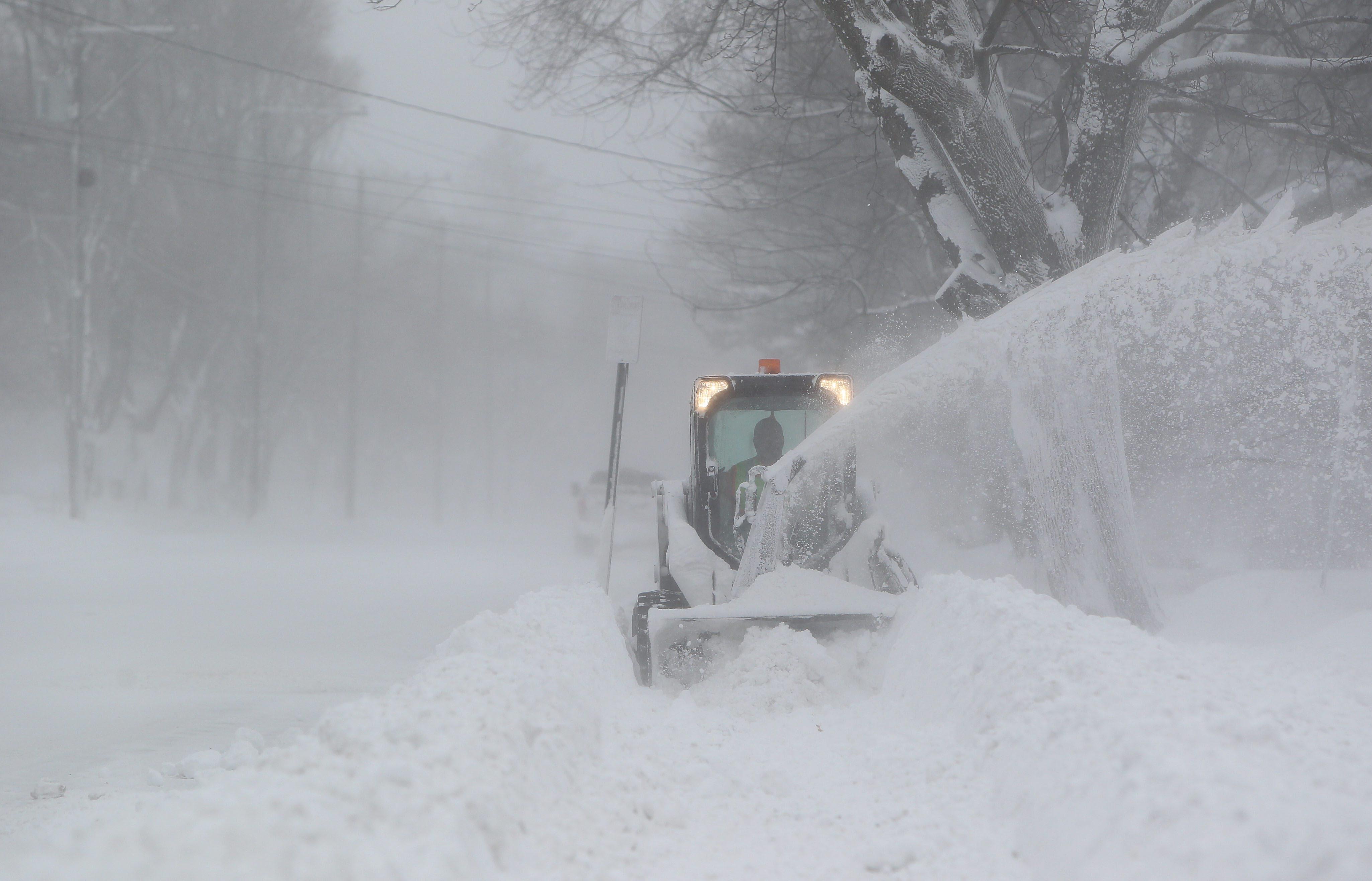 Crews clear the sidewalks on Buffalo Road in Orchard Park, Tuesday Jan. 7, 2014.  (Mark Mulville/Buffalo News)